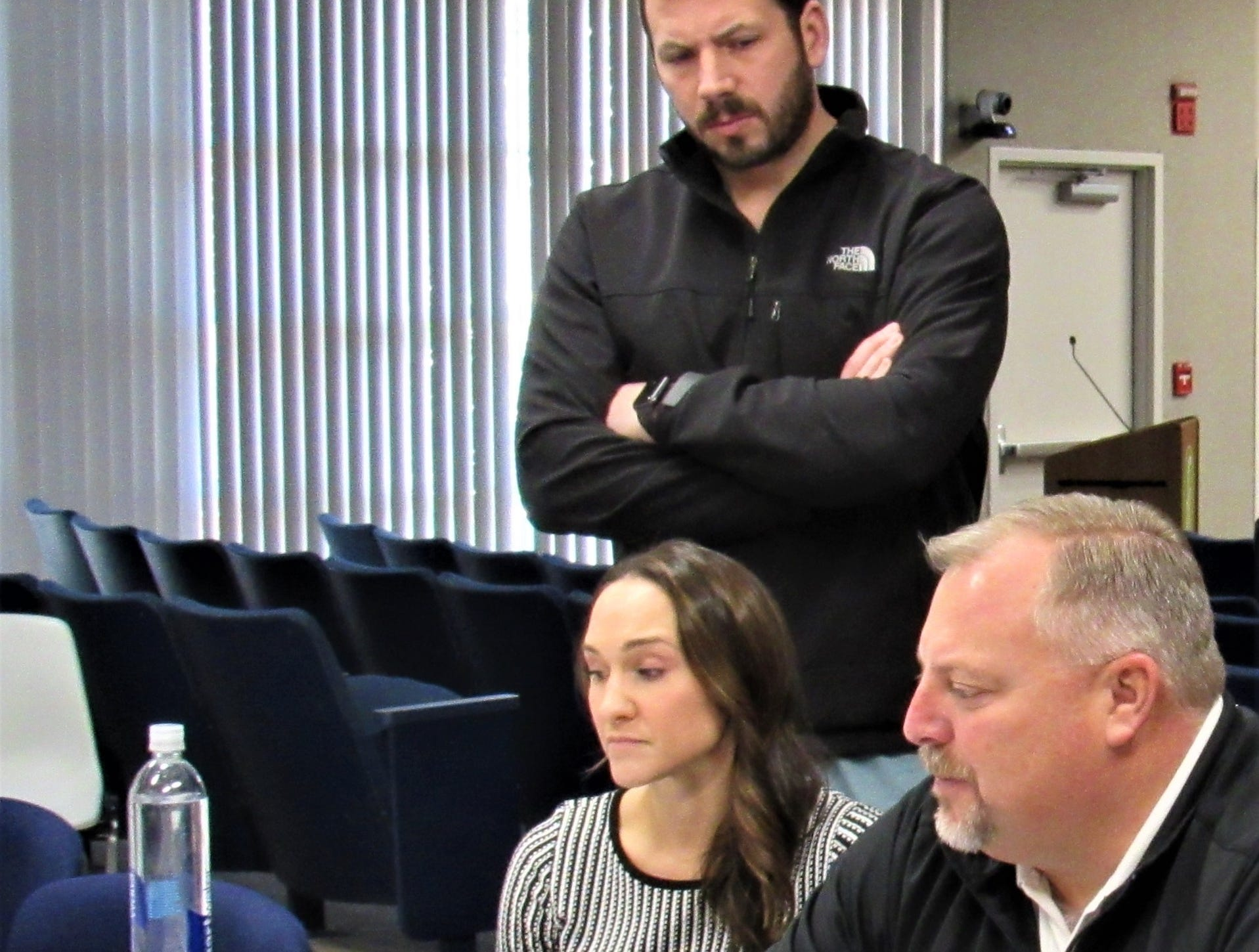 Alderman Drew Burnette looks over plans presented by architect Samia Coker and Ingles construction project manager Preston Kendall during the staff/developer meeting at Town Hall on March 5.