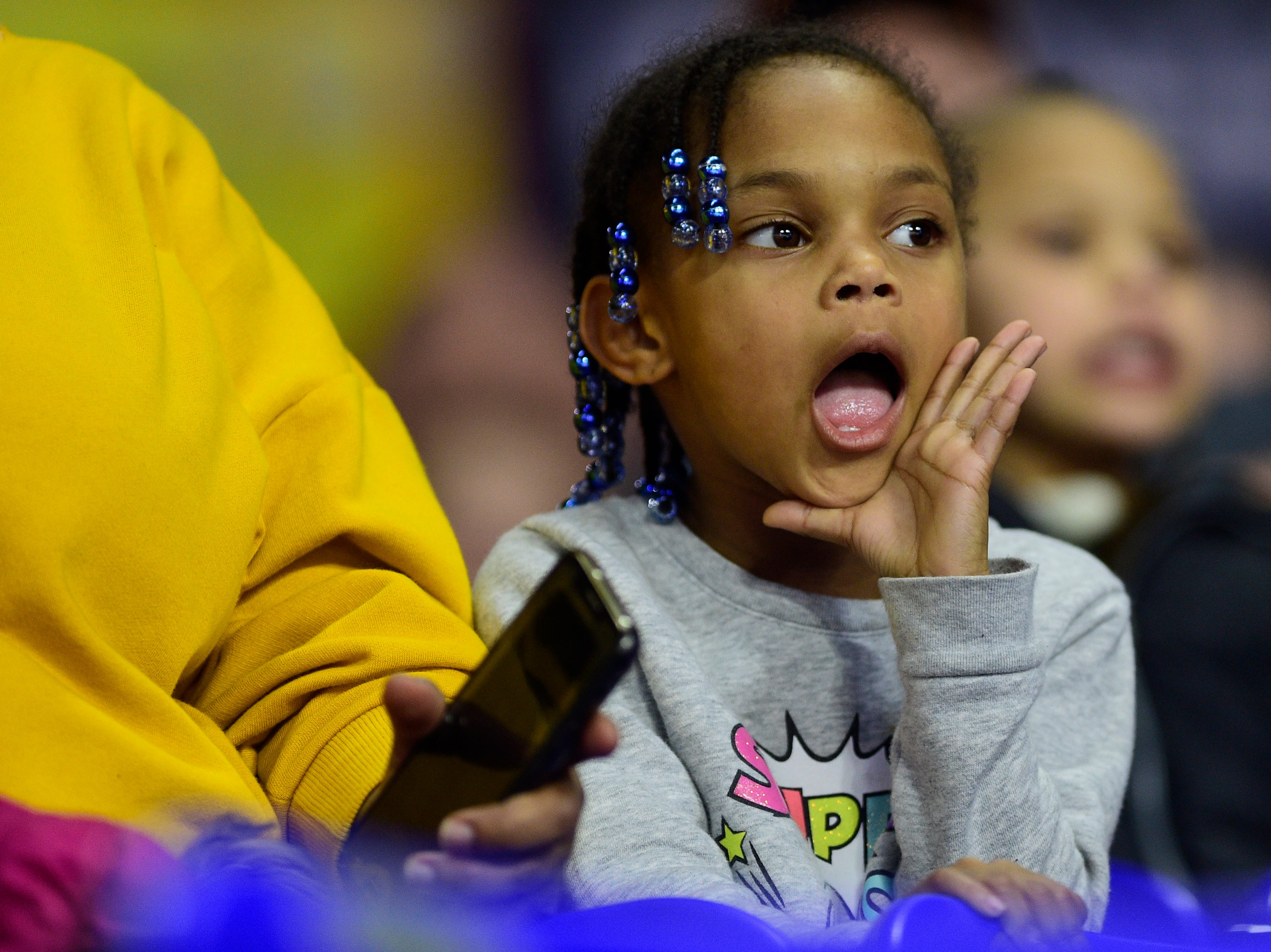 A young Oak Ridge fan cheers during a game between Oak Ridge and Bradley Central at the TSSAA girls state tournament at the Murphy Center in Murfreesboro, Tennessee on Friday, March 8, 2019.