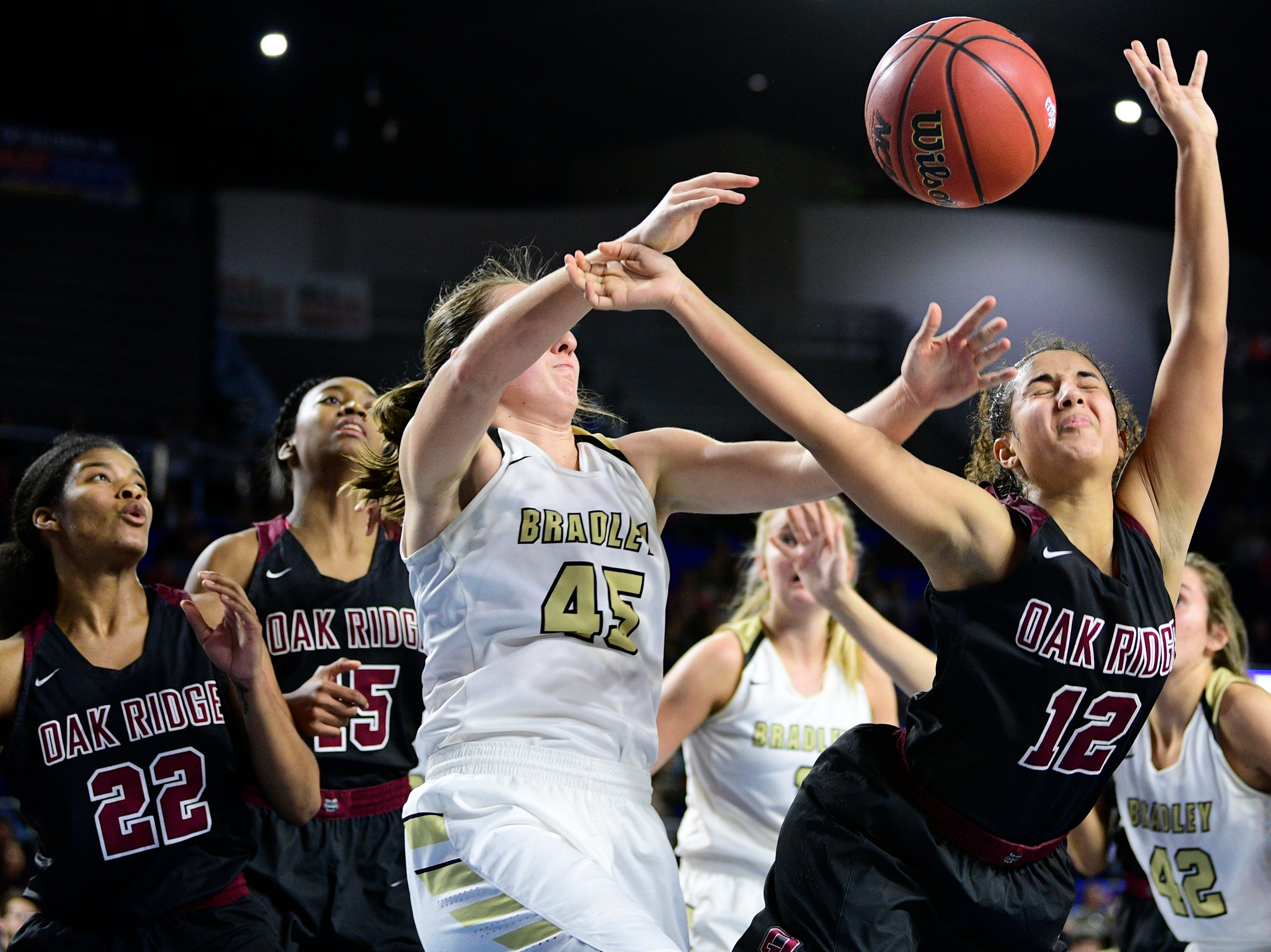 Oak Ridge's Brianna Dunbar (12) loses the ball as Bradley Central's Hannah Lombard (45) defends during a game between Oak Ridge and Bradley Central at the TSSAA girls state tournament at the Murphy Center in Murfreesboro, Tennessee on Friday, March 8, 2019.