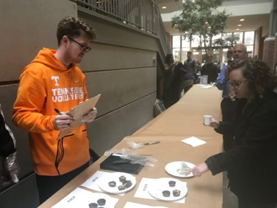 UT senior Peyton Carver collects feedback from taste testers sampling truffles that he and his classmates created.