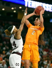 Tennessee's Evina Westbrook, left, shoots a 3-point shot over Mississippi State's Jordan Danberry during the first half of an NCAA college basketball game at the Southeastern Conference women's tournament, Friday, March 8, 2019, in Greenville, S.C.