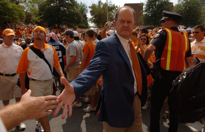UT offensive coordinator David Cutcliffe shakes hands with fans on his way to the stadium during the Vol Walk on Saturday at Neyland Stadium. 09/02/2006.