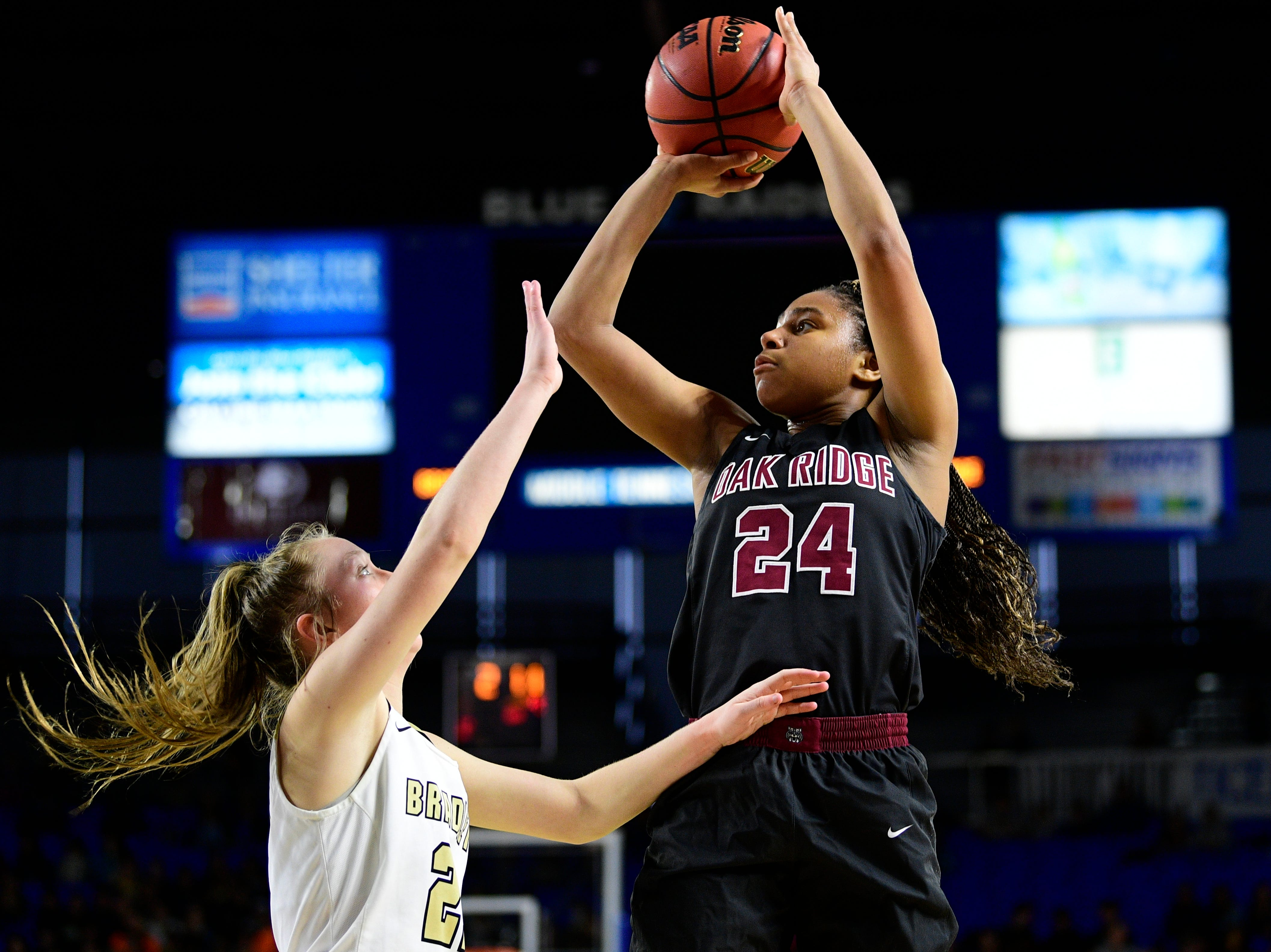 Oak Ridge's Jada Guinn (24) shoots the ball past Bradley Central's Jamie Williams (2) during a game between Oak Ridge and Bradley Central at the TSSAA girls state tournament at the Murphy Center in Murfreesboro, Tennessee on Friday, March 8, 2019.