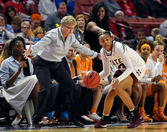 Mississippi State's Bre'Amber Scott recovers a loose ball in front of Tennessee's bench and coach Holly Warlick during the first half of an NCAA college basketball game at the Southeastern Conference women's tournament, Friday, March 8, 2019, in Greenville, S.C. (AP Photo/Richard Shiro)