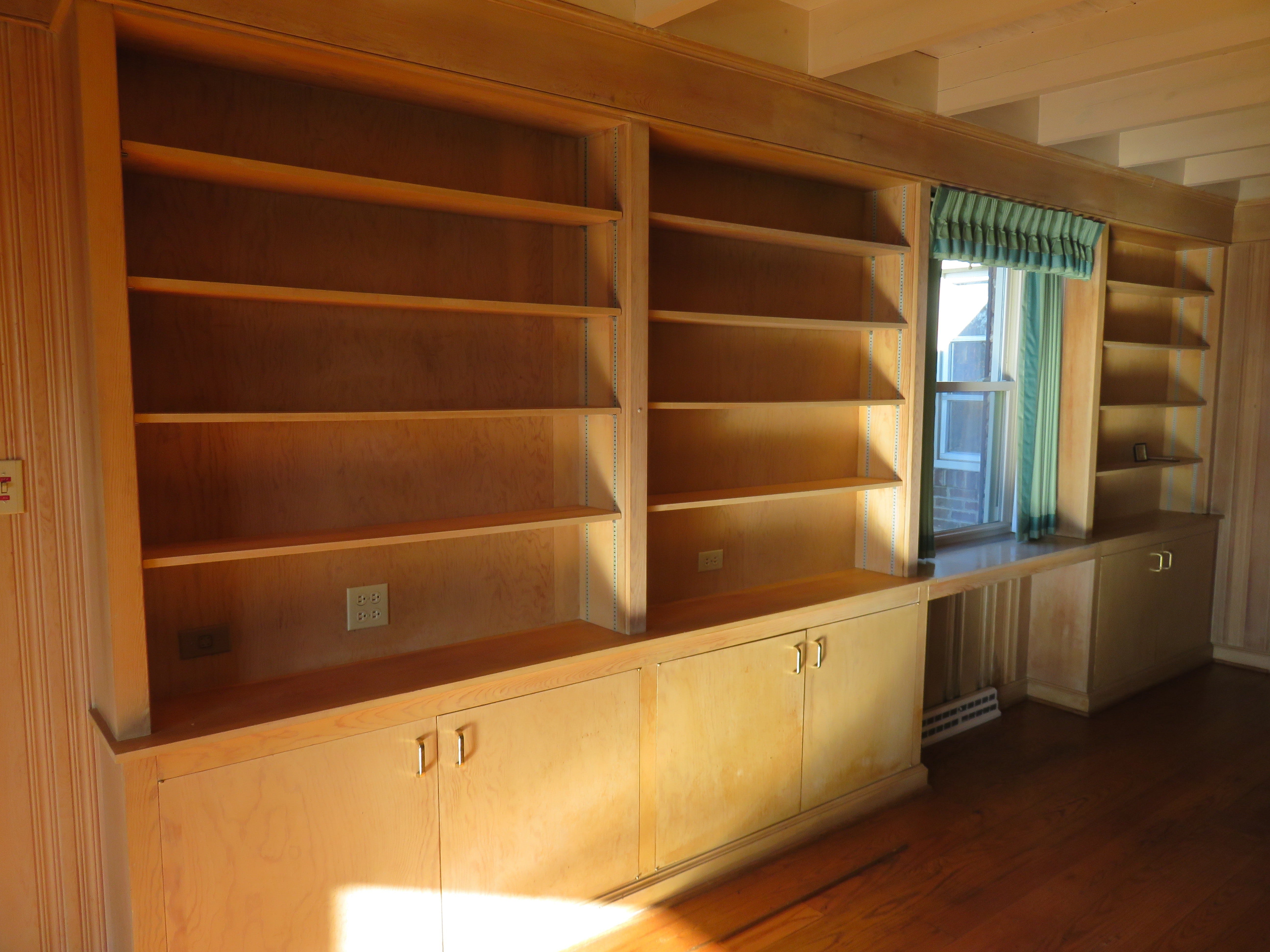 Built-in bookcase in paneled room of Rodgers home.