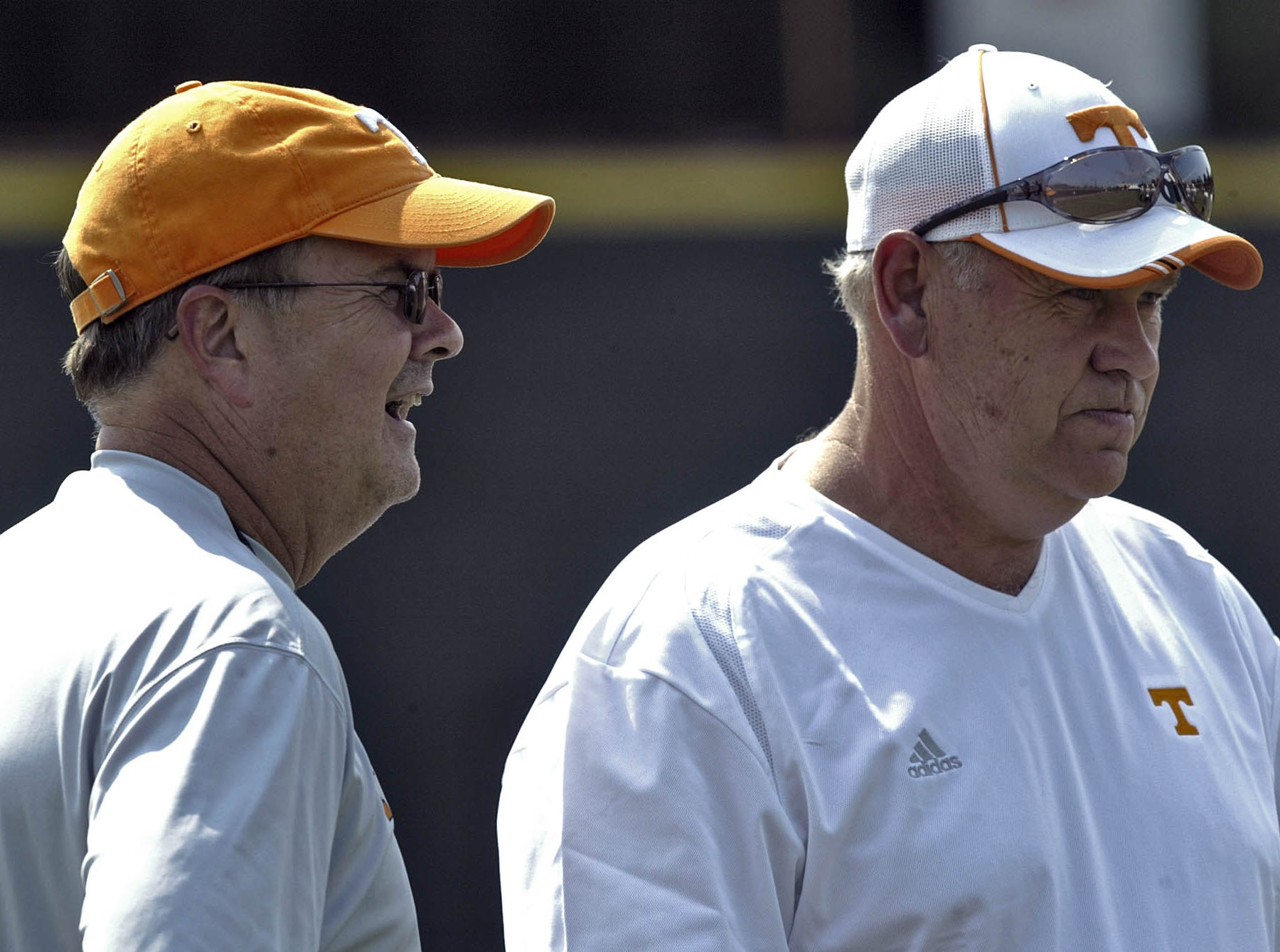 ** ADVANCE FOR WEDNESDAY, AUG. 15 ** Tennessee head coach Phillip Fulmer, right, listens to offensive coordinator David Cutcliffe as they watch during a football practice Tuesday, Aug. 14, 2007, in Knoxville, Tenn.