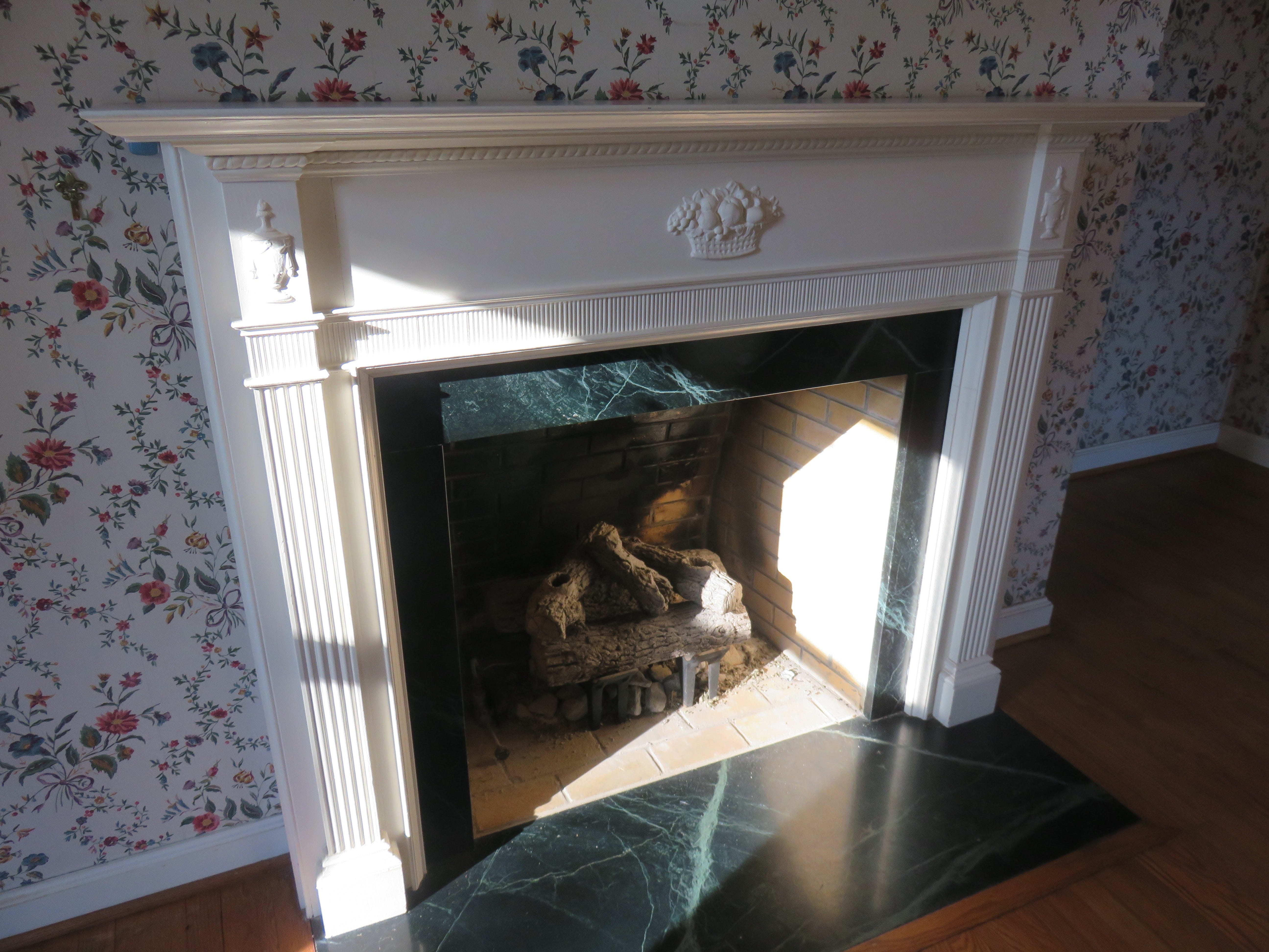 Vintage fireplace mantel taken from former family home by UT campus.