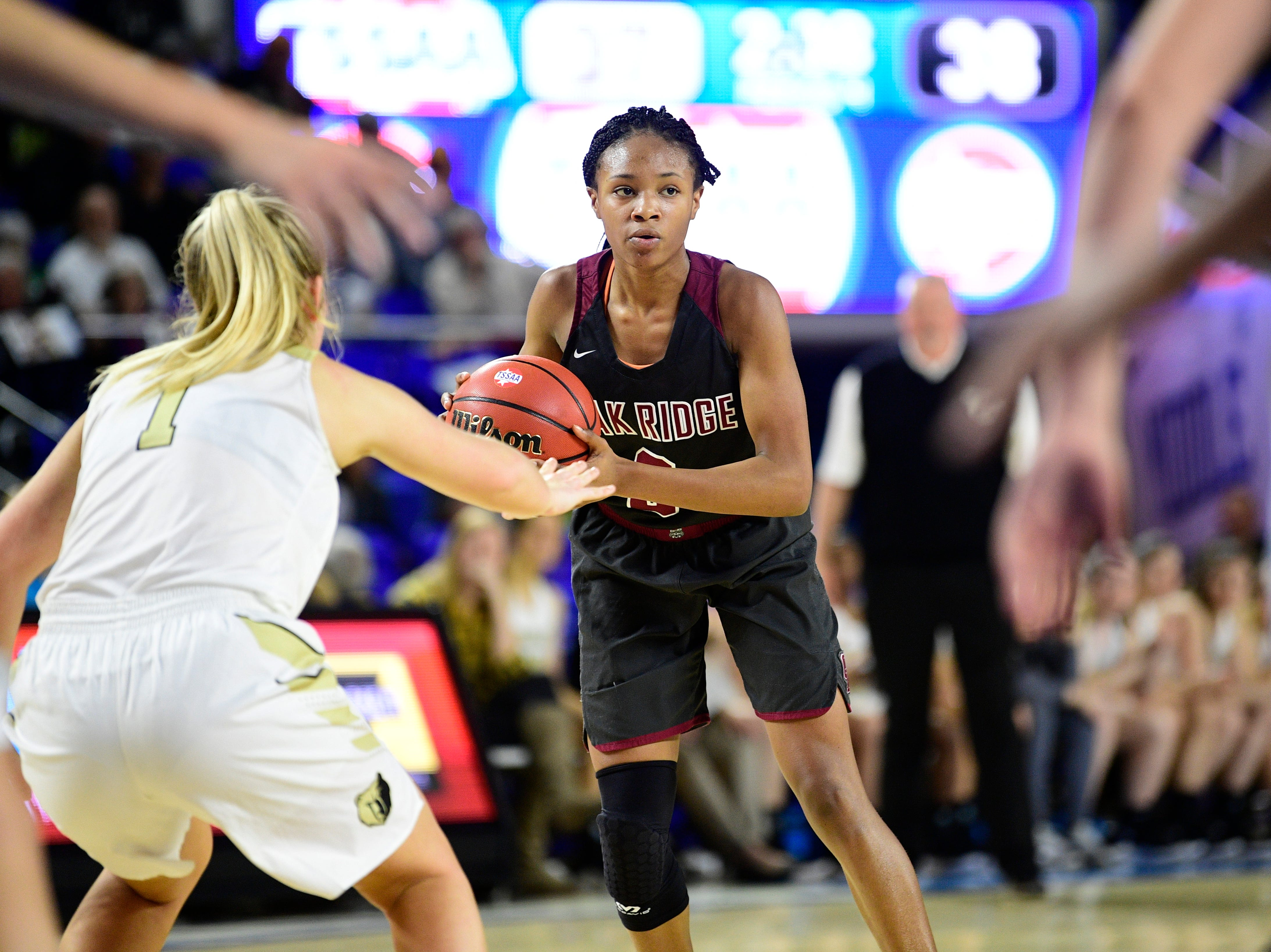 Oak Ridge's Khamari Mitchell-Steens (2) looks to pass during a game between Oak Ridge and Bradley Central at the TSSAA girls state tournament at the Murphy Center in Murfreesboro, Tennessee on Friday, March 8, 2019.
