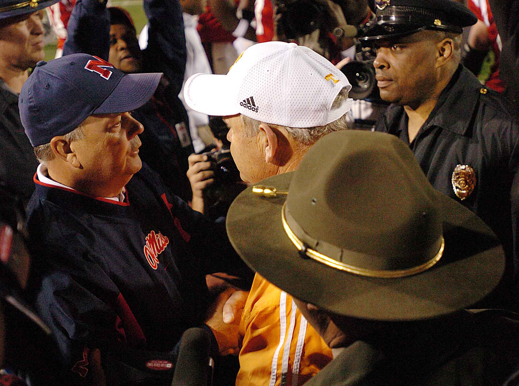 Ole Miss head coach David Cutcliffe, left, and Tennessee head coach Phillip Fulmer meet on the field after the Vols 21-17 win Saturday in Oxford.      10/16/2004