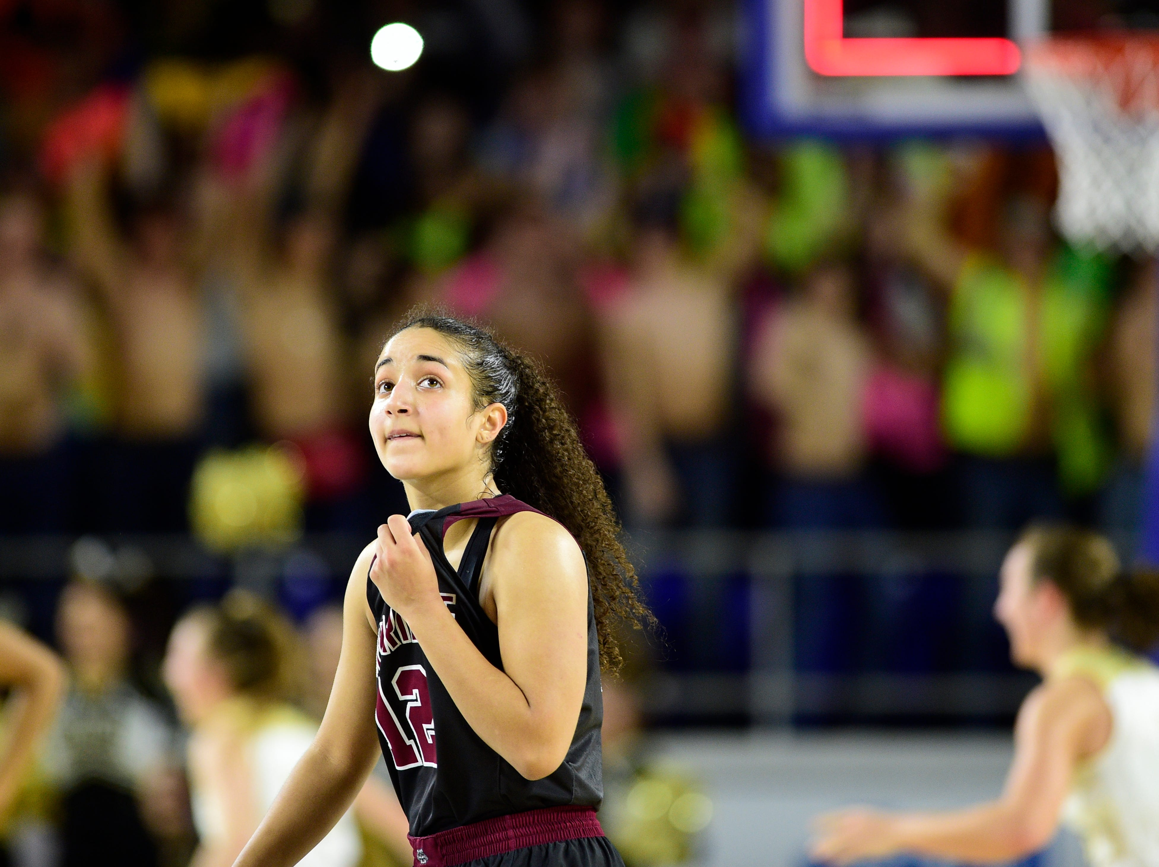 Oak Ridge's Brianna Dunbar (12) reacts after losing to Bradley Central 56-50 in overtime at the TSSAA girls state tournament at the Murphy Center in Murfreesboro, Tennessee on Friday, March 8, 2019.