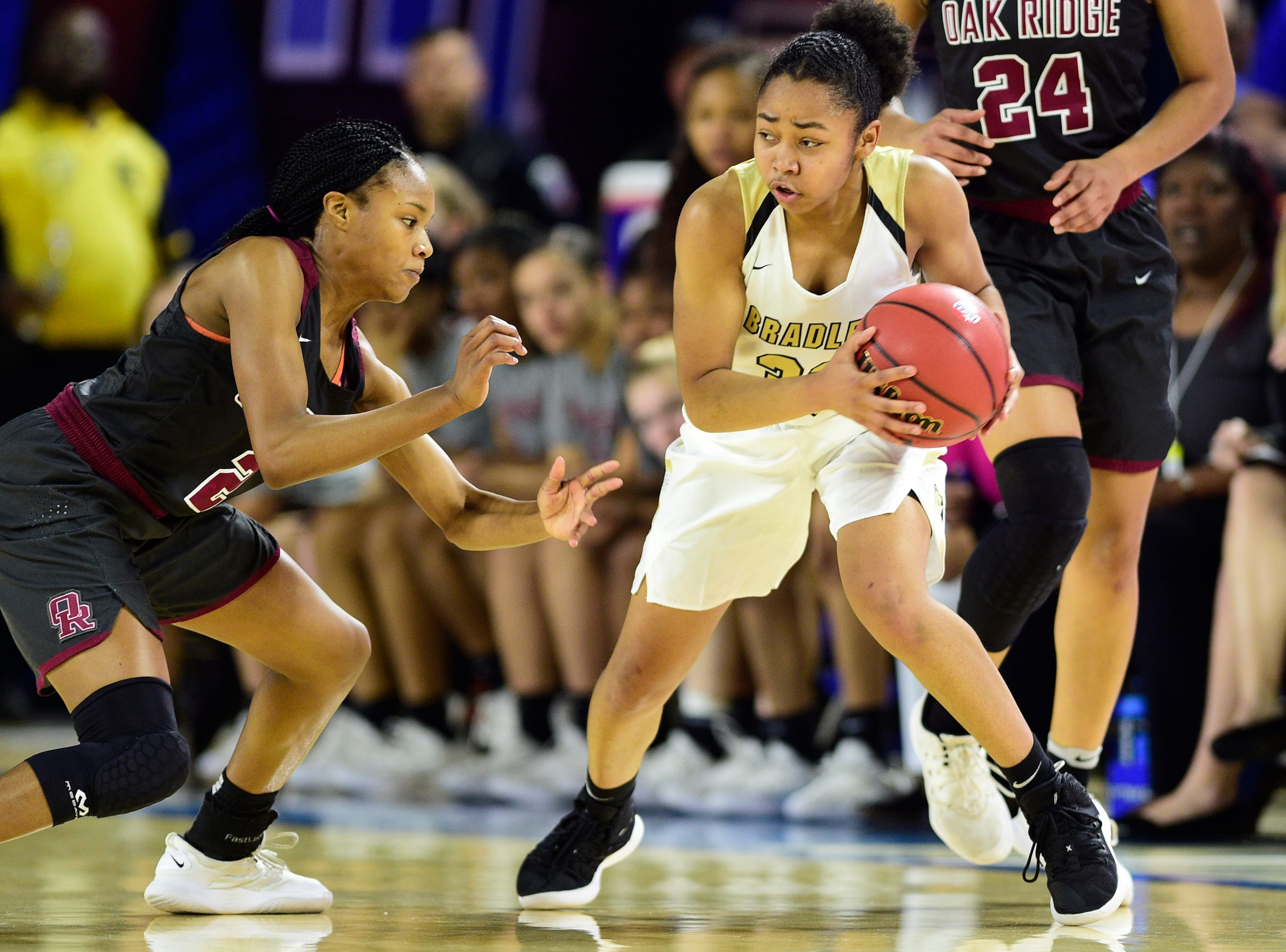 Bradley Central's Jamaryn Blair (33) controls the ball as Oak Ridge's Khamari Mitchell-Steens (2) defends during a game between Oak Ridge and Bradley Central at the TSSAA girls state tournament at the Murphy Center in Murfreesboro, Tennessee on Friday, March 8, 2019.