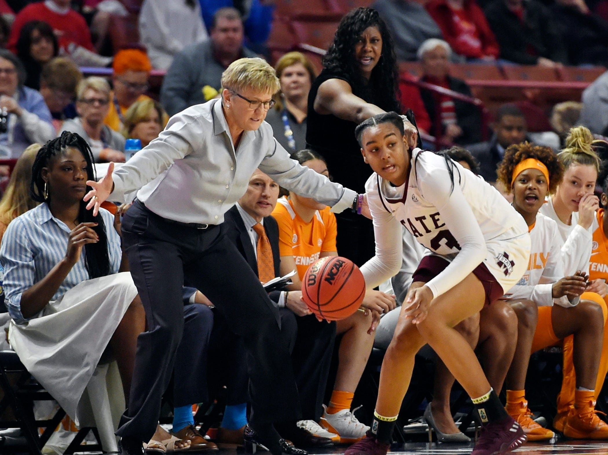 Mississippi State's Bre'Amber Scott recovers a loose ball in front of Tennessee's bench and coach Holly Warlick during the first half of an NCAA college basketball game at the Southeastern Conference women's tournament, Friday, March 8, 2019, in Greenville, S.C.