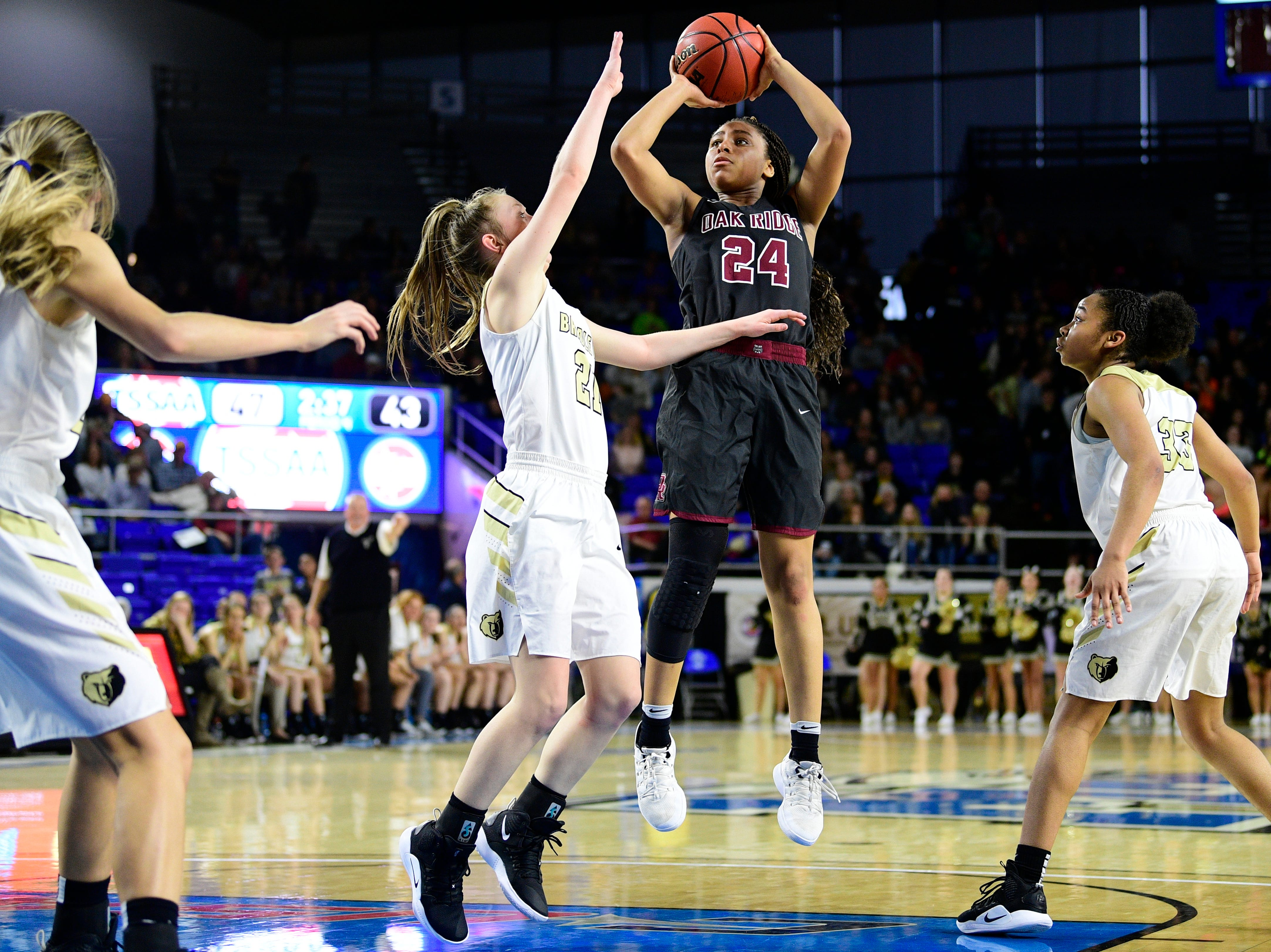 Oak Ridge's Jada Guinn (24) shoots the ball during overtime during a game between Oak Ridge and Bradley Central at the TSSAA girls state tournament at the Murphy Center in Murfreesboro, Tennessee on Friday, March 8, 2019.