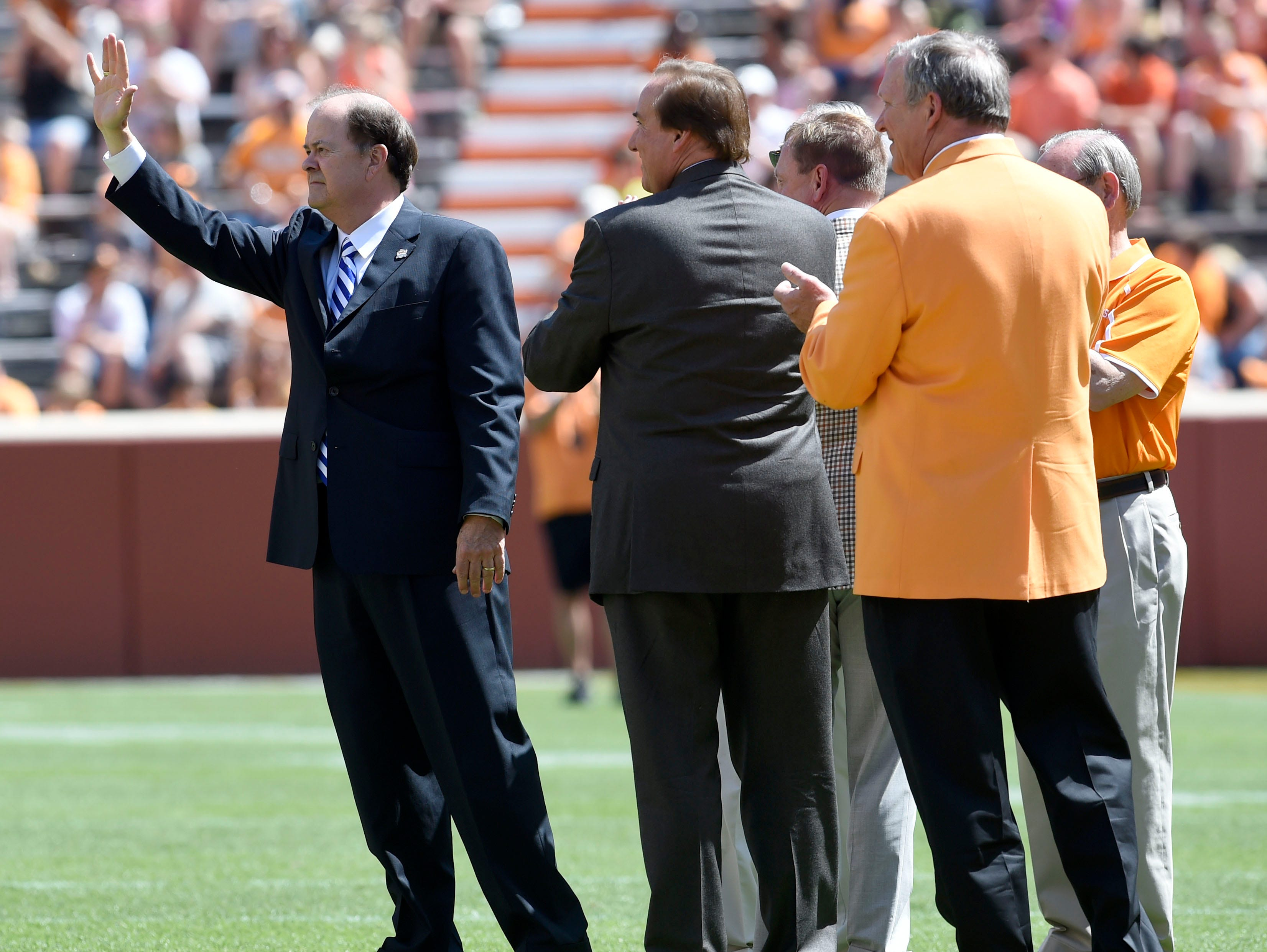 Duke head coach David Cutcliffe is acknowledged after receiving the Neyland Award for coaching during the Orange and White spring game at Neyland Stadium, Saturday, April 12, 2014.