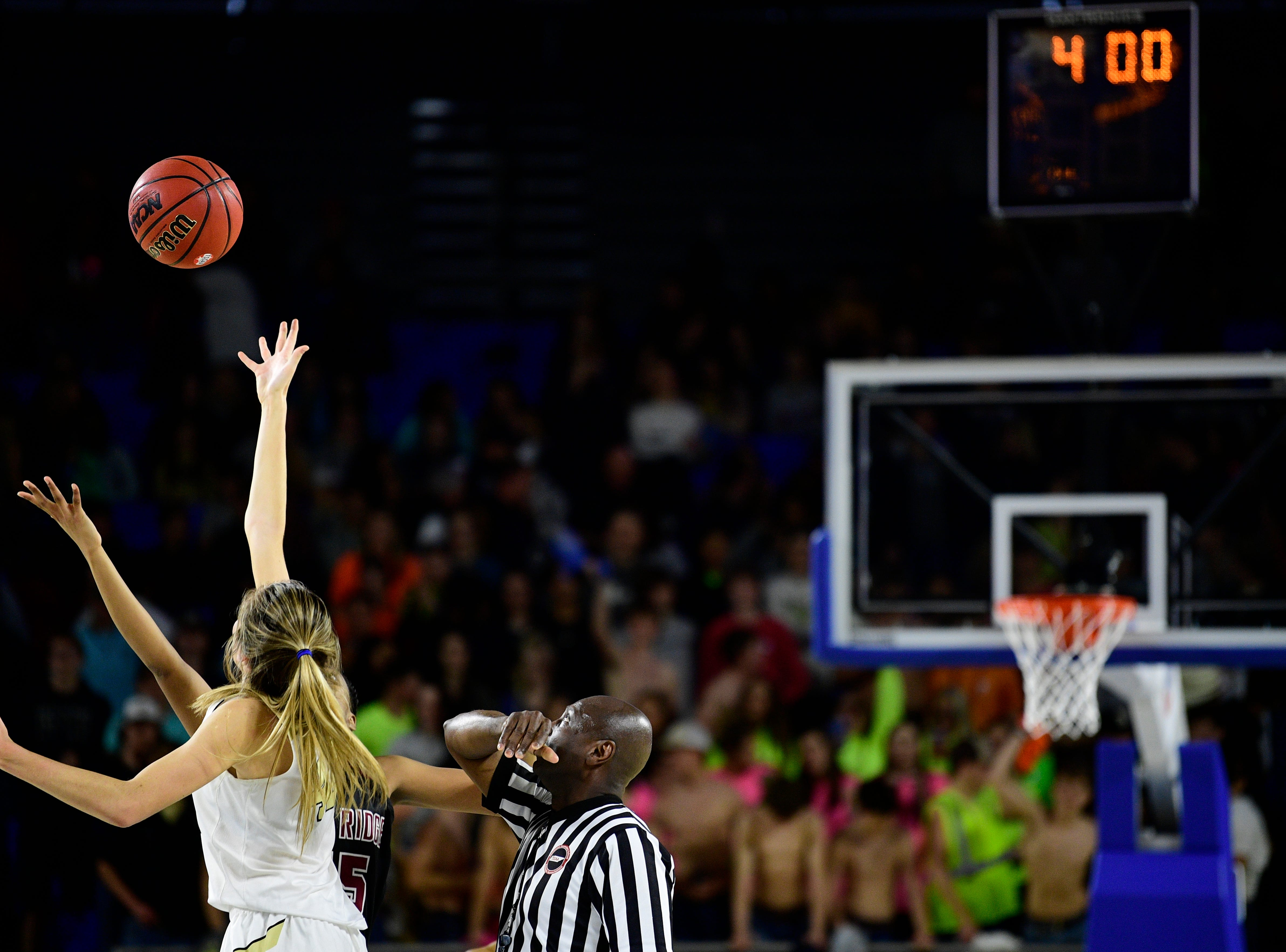 Bradley Central's Anna Walker (42) and Oak Ridge's Raja Eckles (15) tip off in overtime during a game between Oak Ridge and Bradley Central at the TSSAA girls state tournament at the Murphy Center in Murfreesboro, Tennessee on Friday, March 8, 2019.