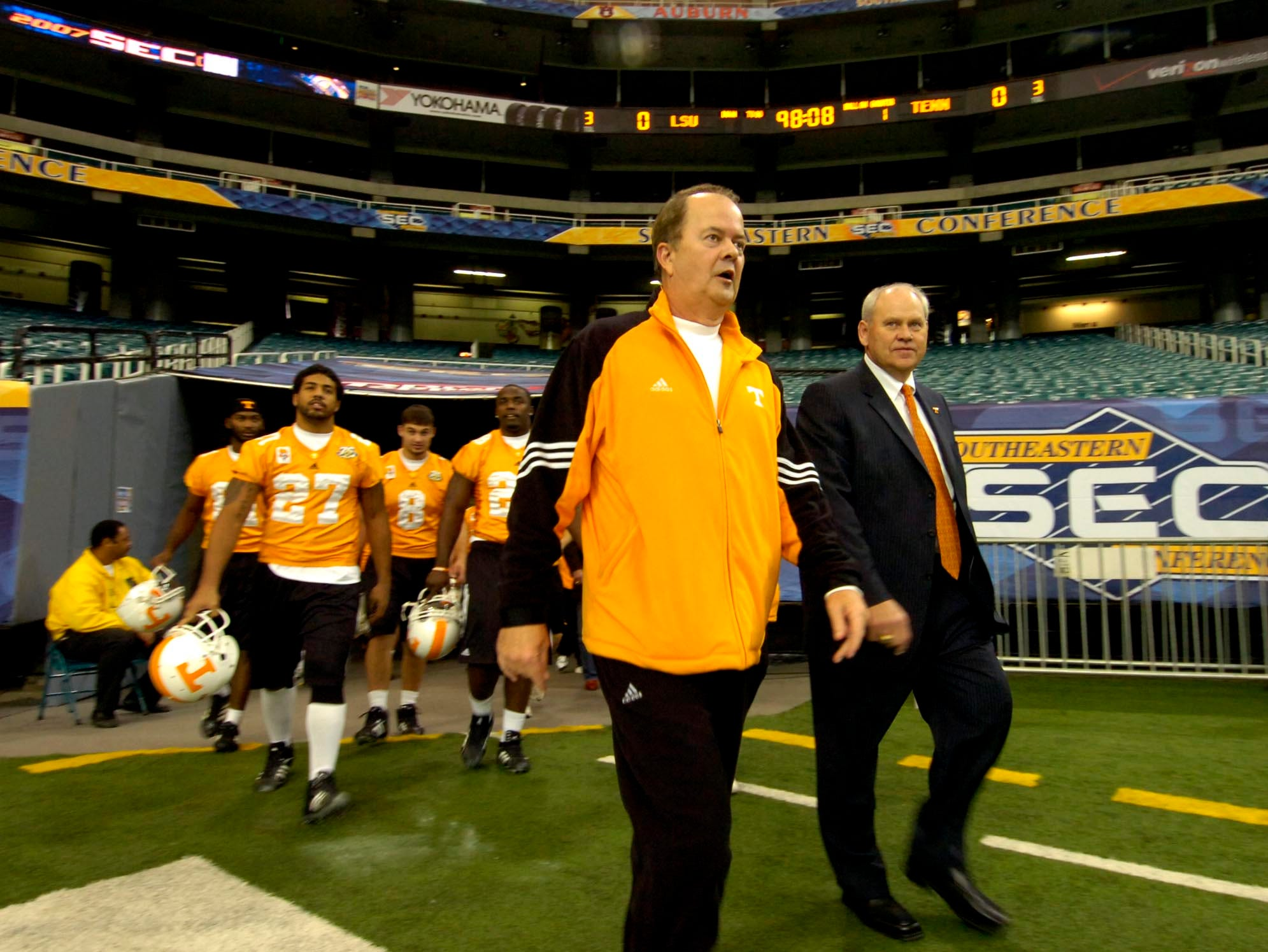 frisec3.MP    MICHAEL PATRICK/NEWS SENTINEL      The University of Tennessee football team led by David Cutcliffe, center, and head coach Phillip Fulmer, right, walk onto the field of the Georgia Dome Friday afternoon for a walk-through practice.  Tennessee plays LSU for the SEC Championship Saturday at 4 p.m.