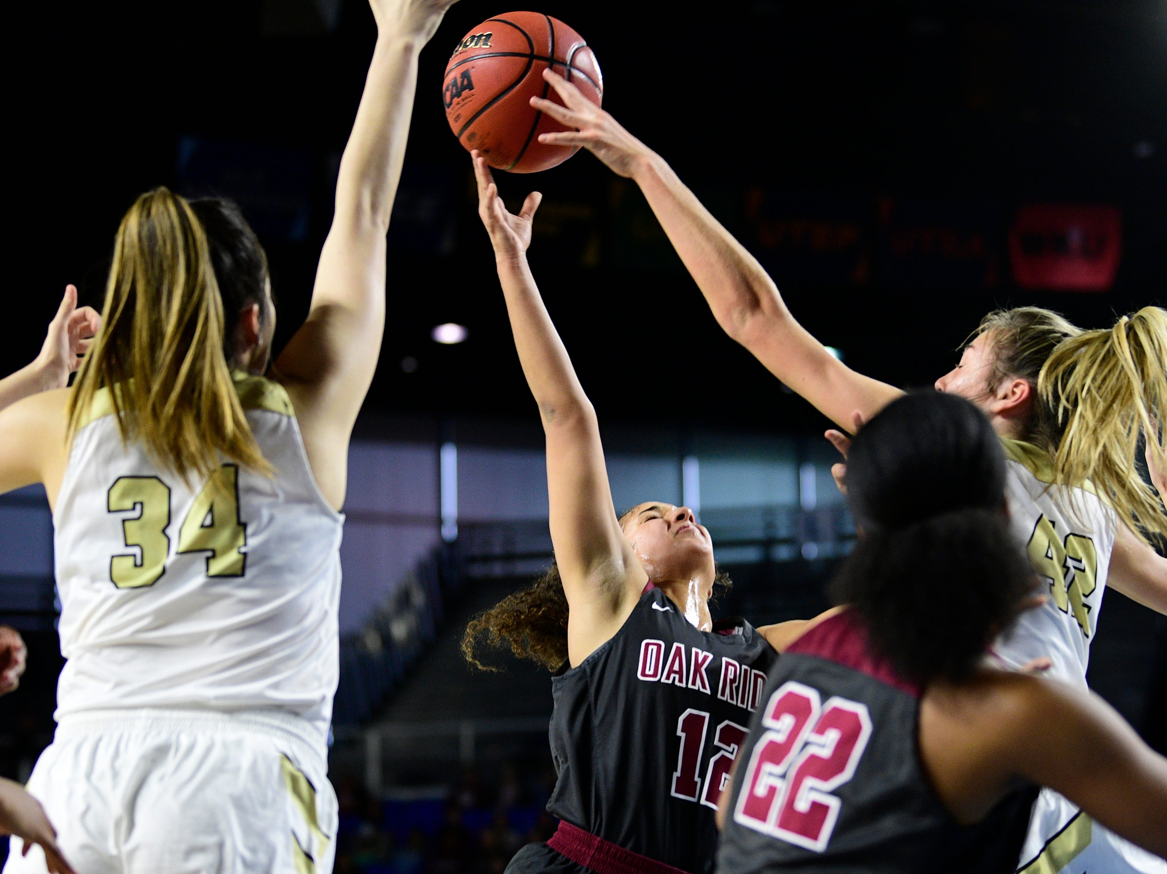 Oak Ridge's Brianna Dunbar (12) shoots the ball during a game between Oak Ridge and Bradley Central at the TSSAA girls state tournament at the Murphy Center in Murfreesboro, Tennessee on Friday, March 8, 2019.