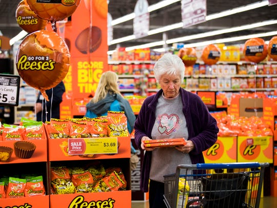 Customers browse the World's Greatest Reese's Display at Food City on Morrell Road in Knoxville on Friday, March 8, 2019.