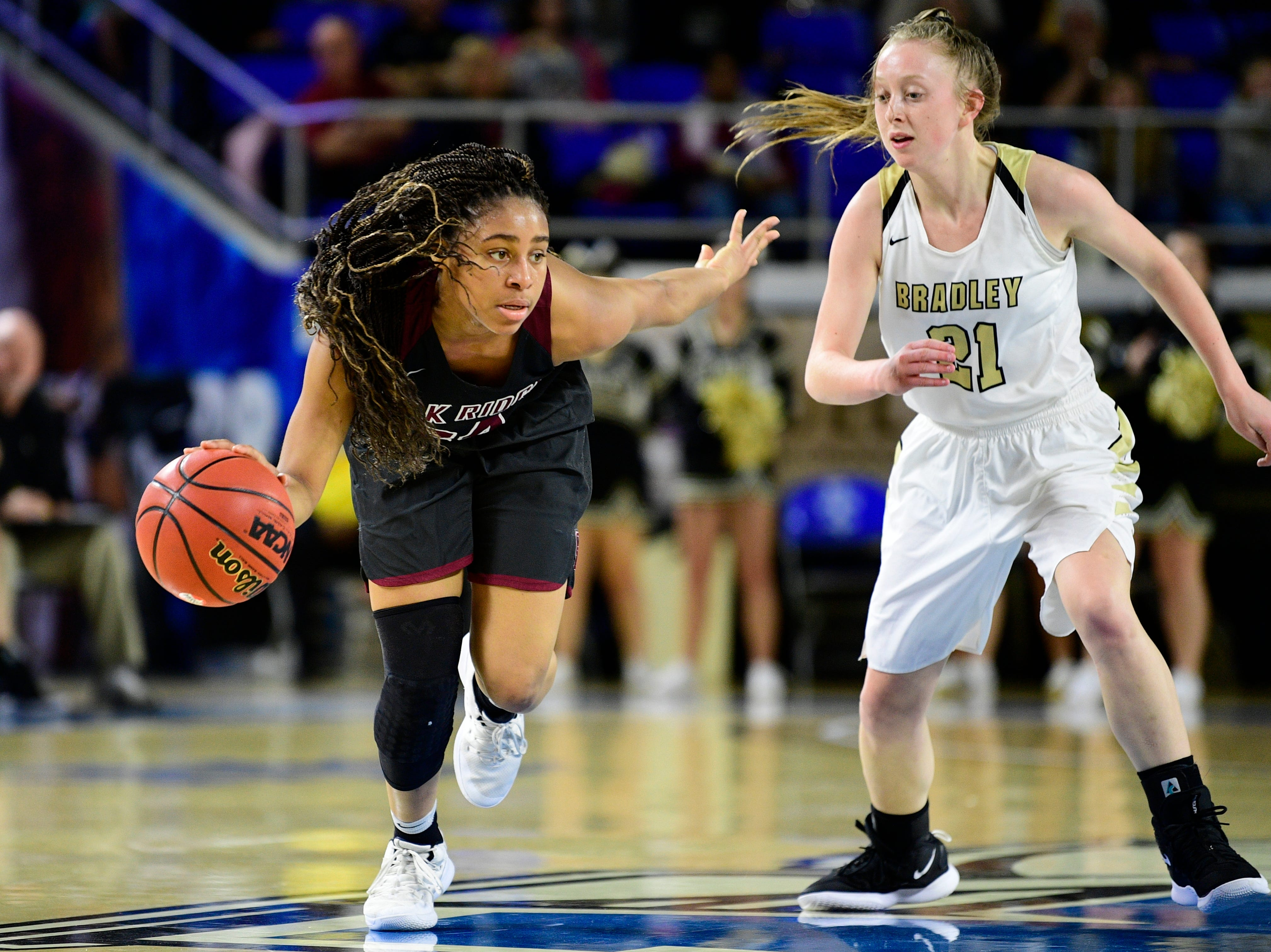 Oak Ridge's Jada Guinn (24) controls the ball as Bradley Central's Cambree Mayo (21) defends during a game between Oak Ridge and Bradley Central at the TSSAA girls state tournament at the Murphy Center in Murfreesboro, Tennessee on Friday, March 8, 2019.
