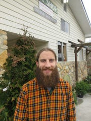 Ellenburg Landscaping & Nursery manager Scott Black smiles on a cold March 4 day while awaiting the warmer days of spring and shopping customers.