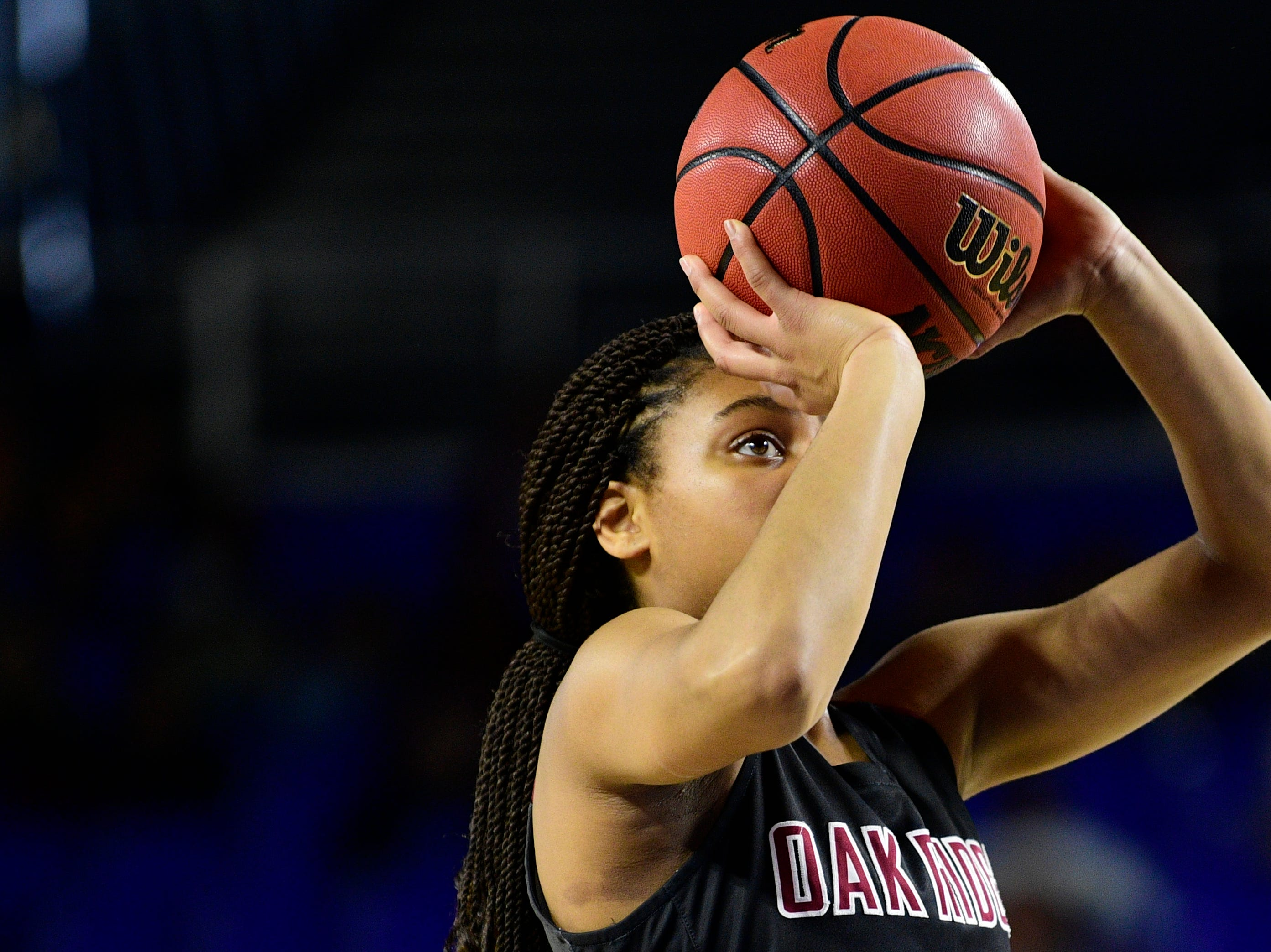 Oak Ridge's Jada Guinn (24) shoots the ball during a game between Oak Ridge and Bradley Central at the TSSAA girls state tournament at the Murphy Center in Murfreesboro, Tennessee on Friday, March 8, 2019.