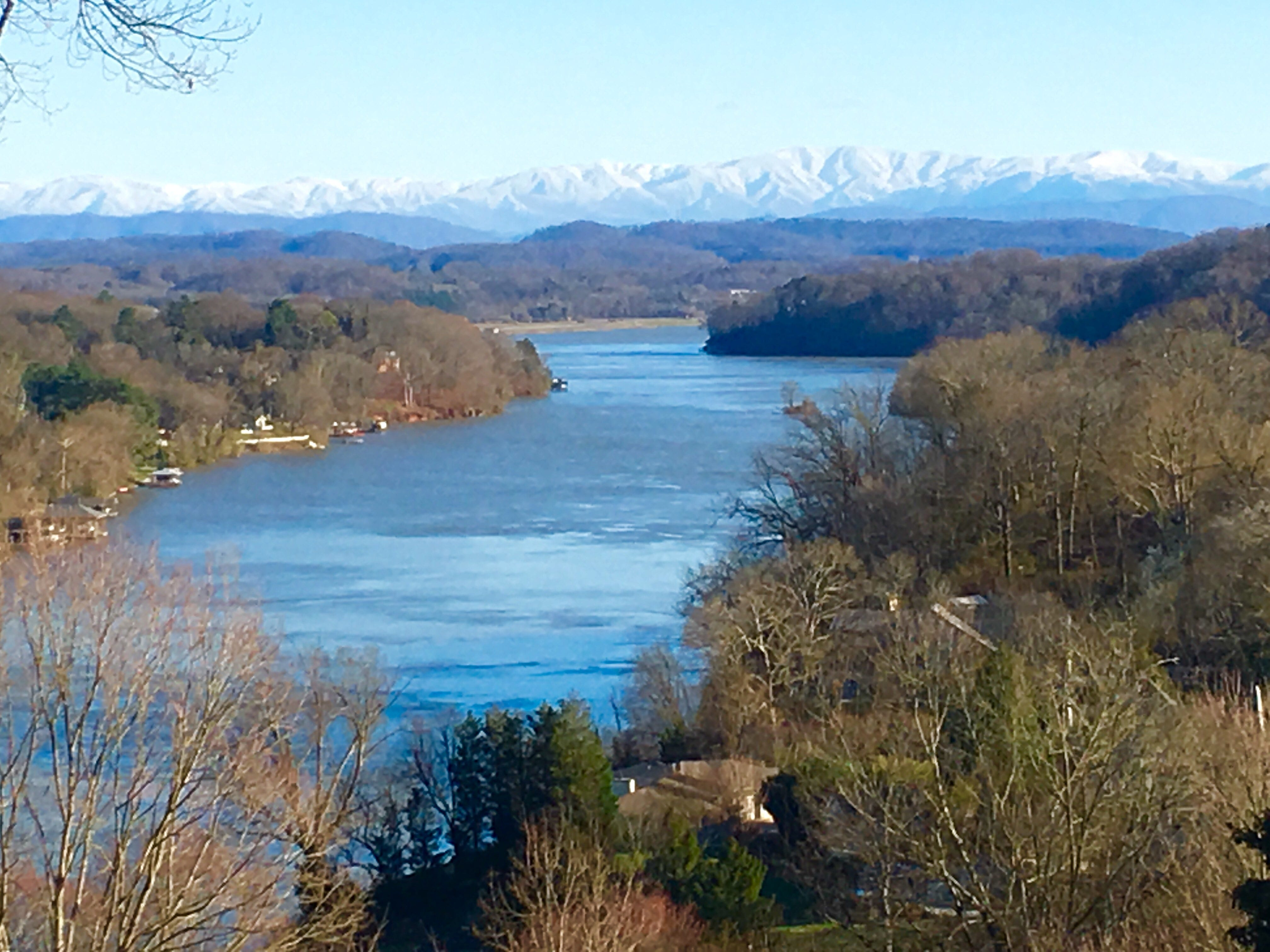 View of river and snowy Smokies from backyard of Rodgers home.
