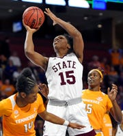 Mississippi State's Teaira McCowan (15) shoots over Tennessee's Zaay Green, left, and Cheridene Green during the first half of an NCAA college basketball game at the Southeastern Conference women's tournament, Friday, March 8, 2019, in Greenville, S.C.