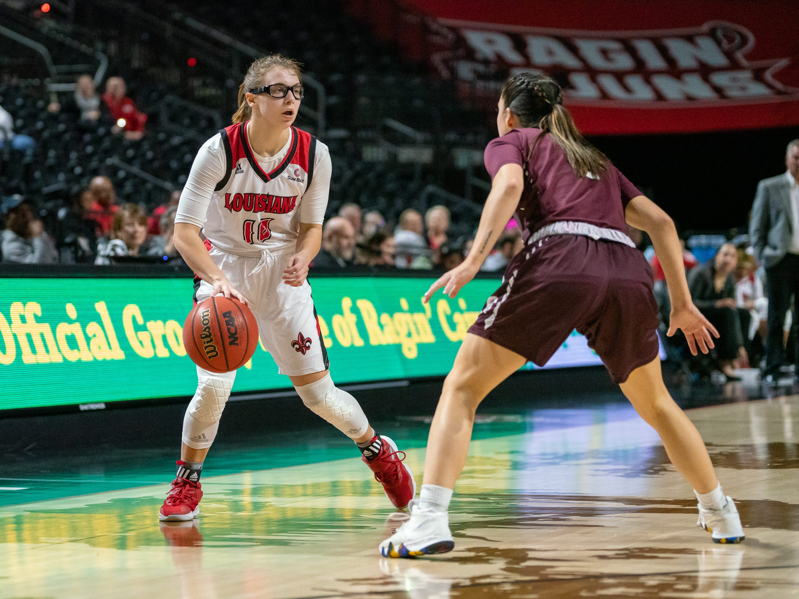 UL's Andrea Cournoyer looks for an open teammate during the play as the Ragin' Cajuns take on the Little Rock Trojans at the Cajundome on Thursday, March 7, 2019.