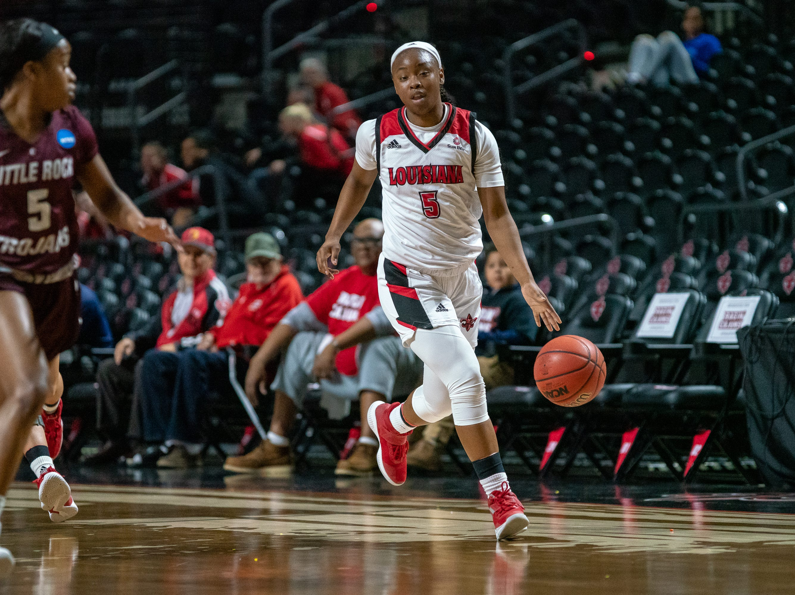 UL's Jomyra Mathis takes the ball down the court as the Ragin' Cajuns take on the Little Rock Trojans at the Cajundome on Thursday, March 7, 2019.
