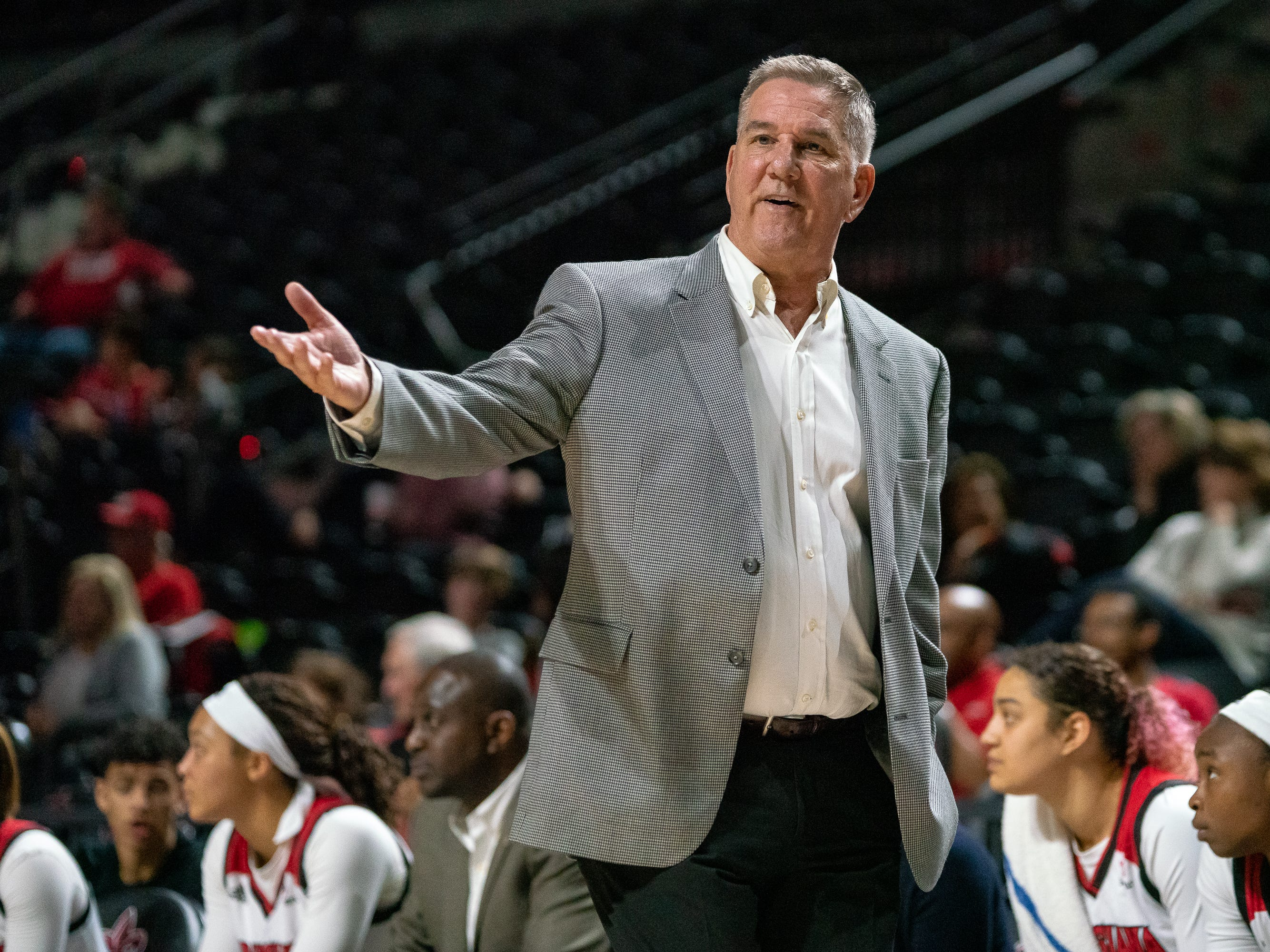 UL's head basketball coach Garry Brodhead talks to his players from the sidelines as the Ragin' Cajuns take on the Little Rock Trojans at the Cajundome on Thursday, March 7, 2019.