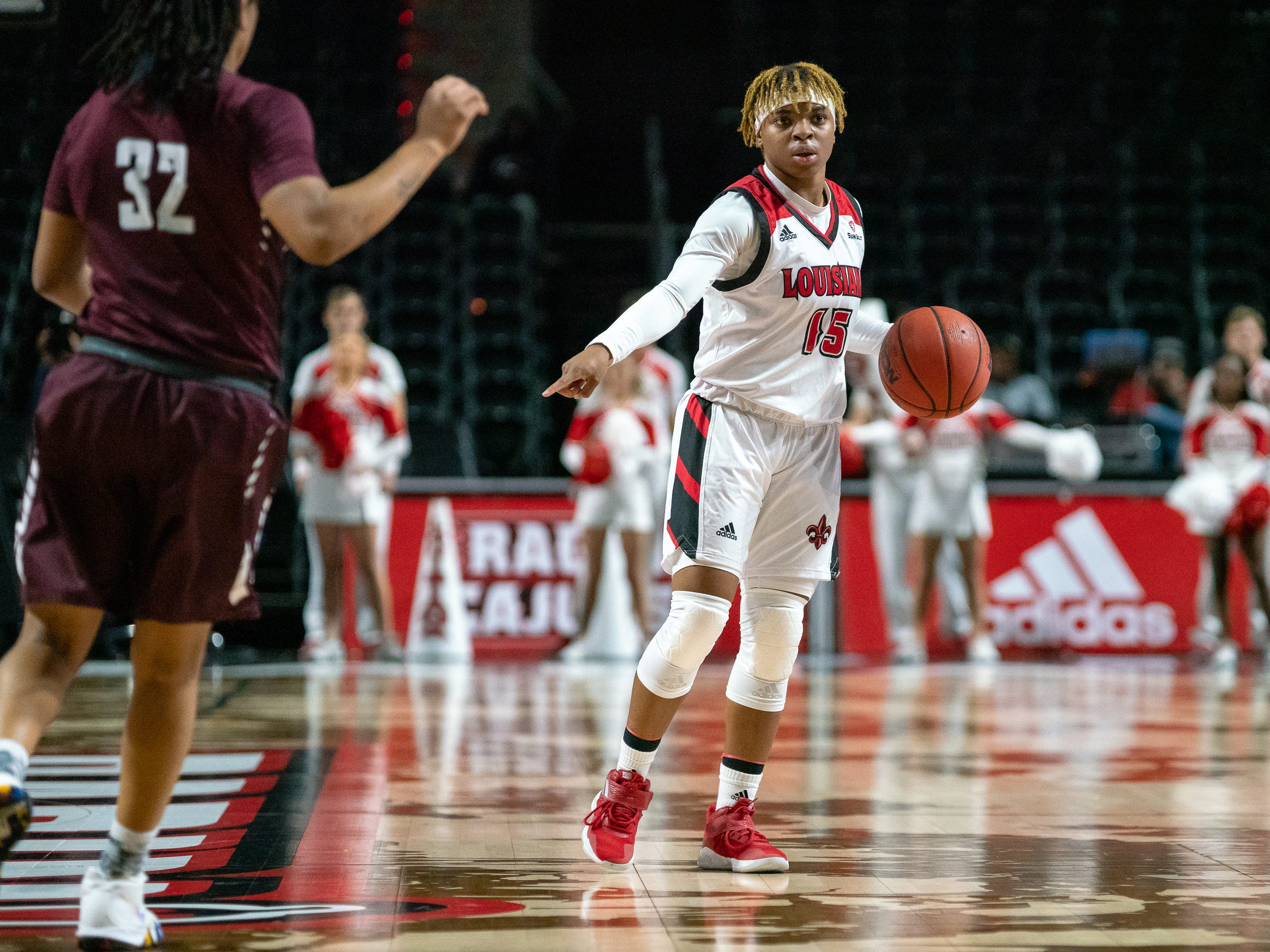 UL's Diamond Morrison directs her teammates on the court as the Ragin' Cajuns take on the Little Rock Trojans at the Cajundome on Thursday, March 7, 2019.