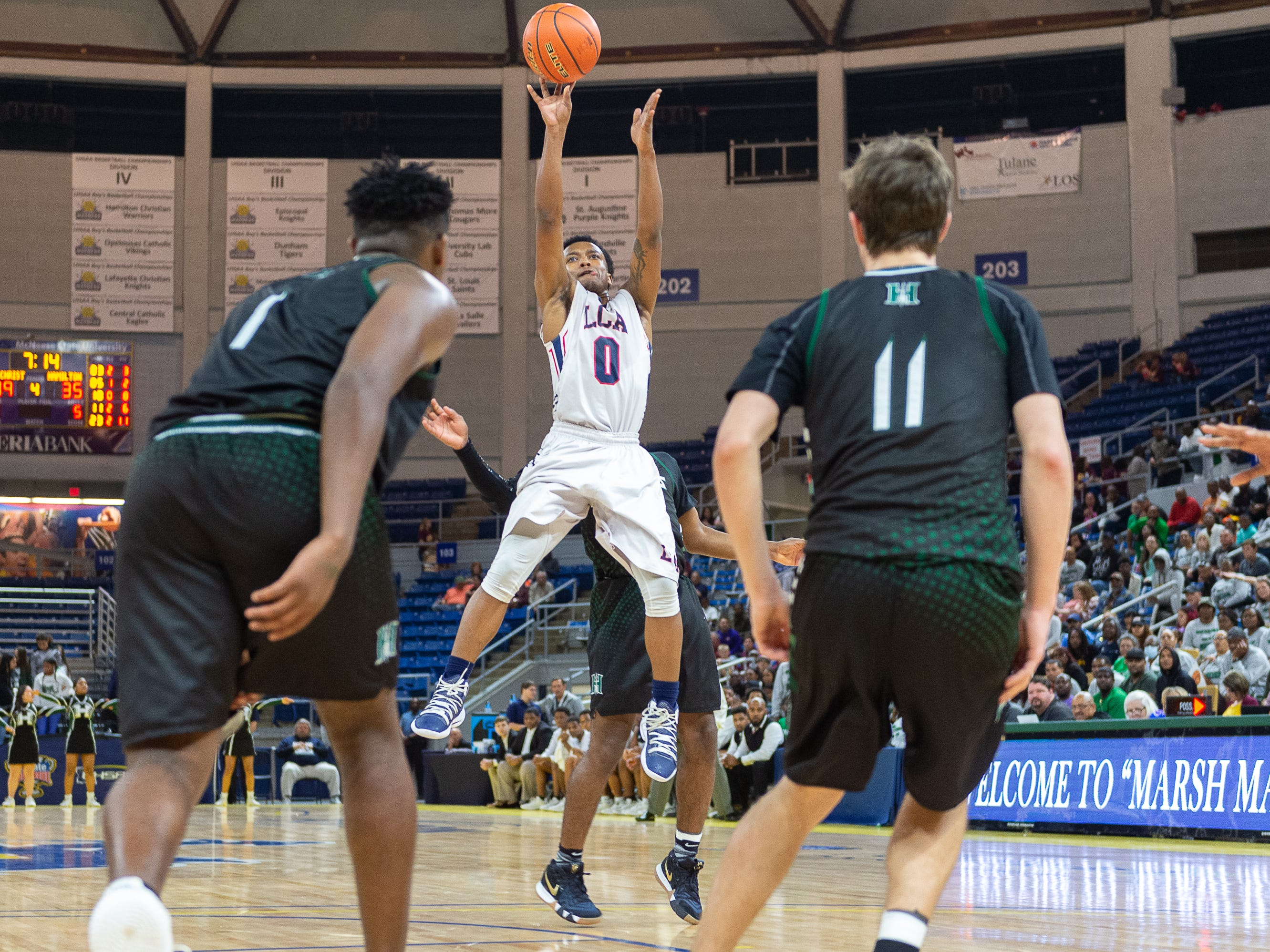 Terrence Jones Jr. takes a shot as Lafayette Christian takes down Hamilton Christian to win the Allstate Sugar Bowl/LHSAA Boys' Marsh Madness State Championship. Friday, March 8, 2019.