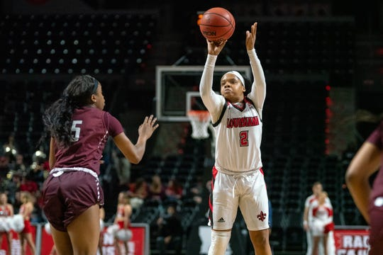 UL's Brandi Williams takes a shot to score as the Ragin' Cajuns take on the Little Rock Trojans at the Cajundome on Thursday, March 7, 2019.
