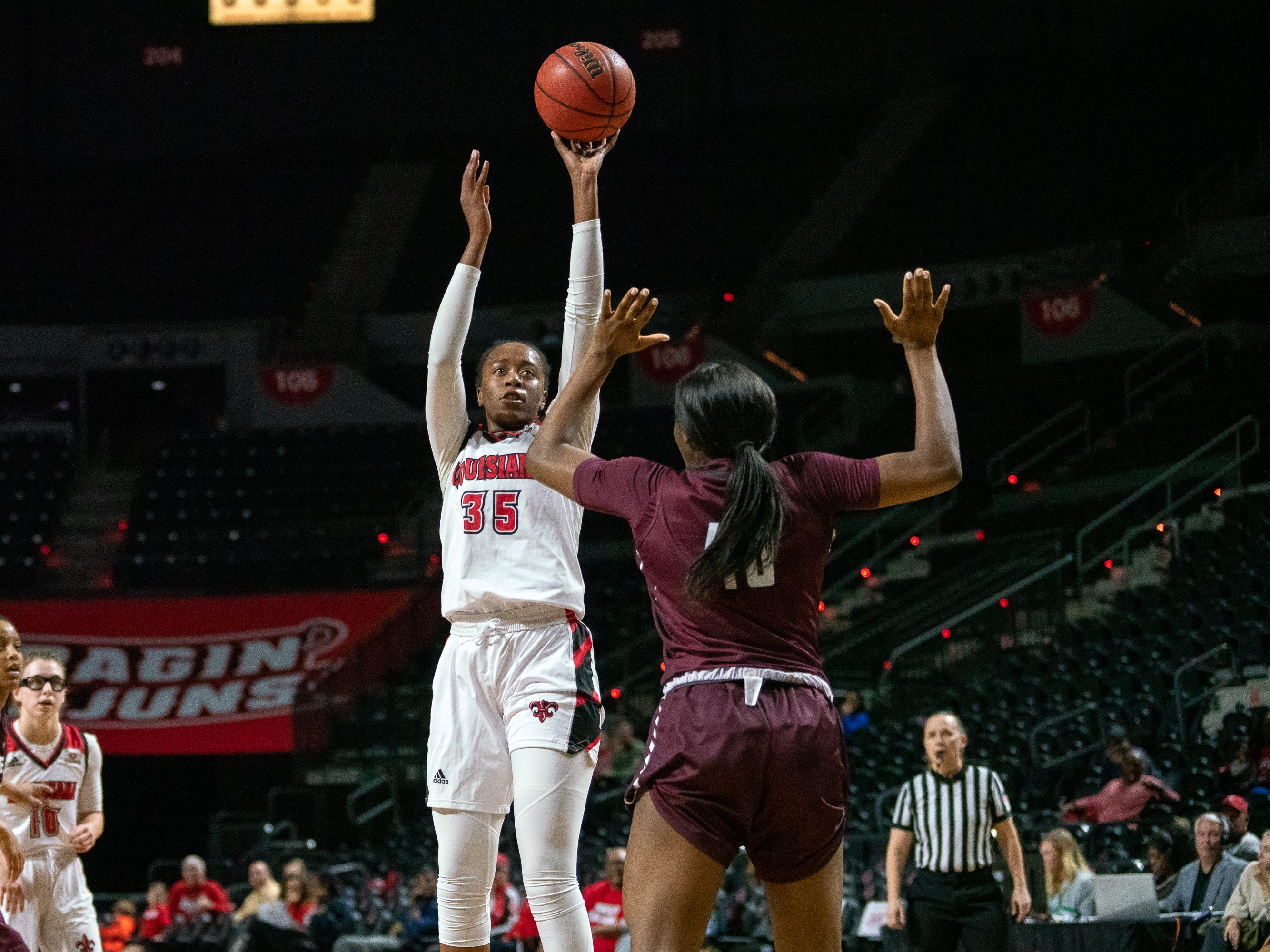 UL's Ty'Reona Doucet shoots to score as the Ragin' Cajuns take on the Little Rock Trojans at the Cajundome on Thursday, March 7, 2019.