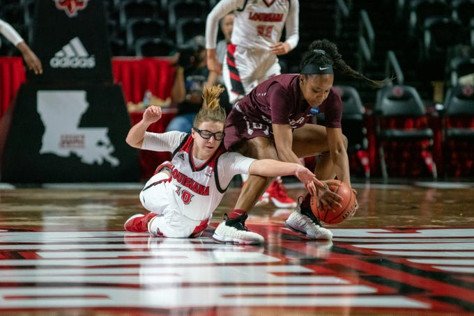 UL's Andrea Cournoyer dives for the ball as the Ragin' Cajuns take on the Little Rock Trojans at the Cajundome on Thursday, March 7, 2019.
