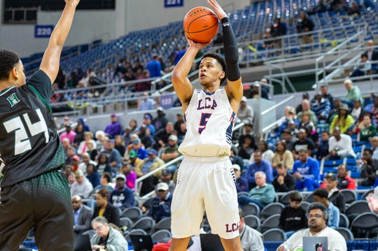 Billy Francis Jr. takes a shot as Lafayette Christian takes down Hamilton Christian to win the Allstate Sugar Bowl/LHSAA Boys' Marsh Madness State Championship. Friday, March 8, 2019.