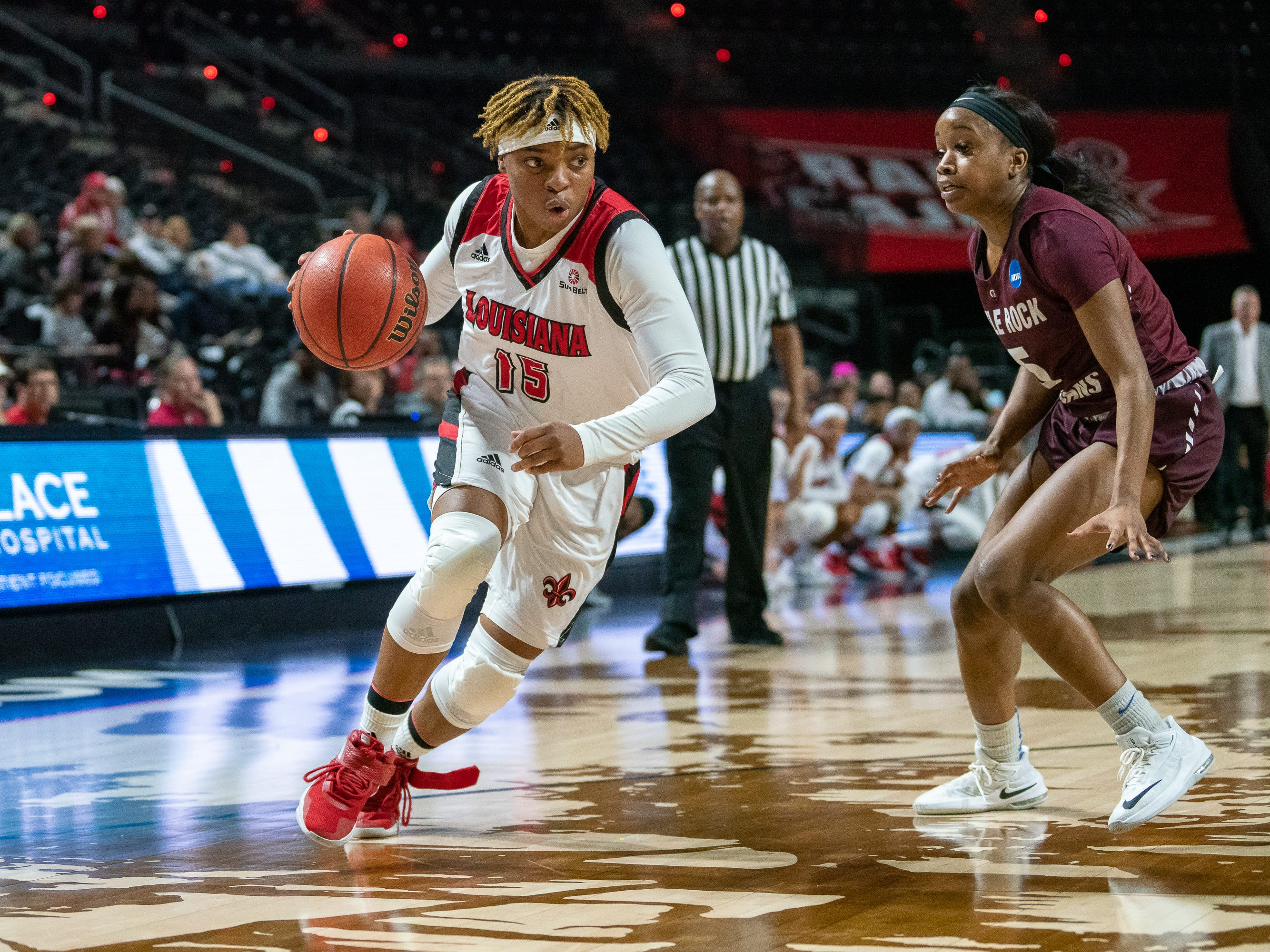 UL's Diamond Morrison drives the ball to the basket as the Ragin' Cajuns take on the Little Rock Trojans at the Cajundome on Thursday, March 7, 2019.