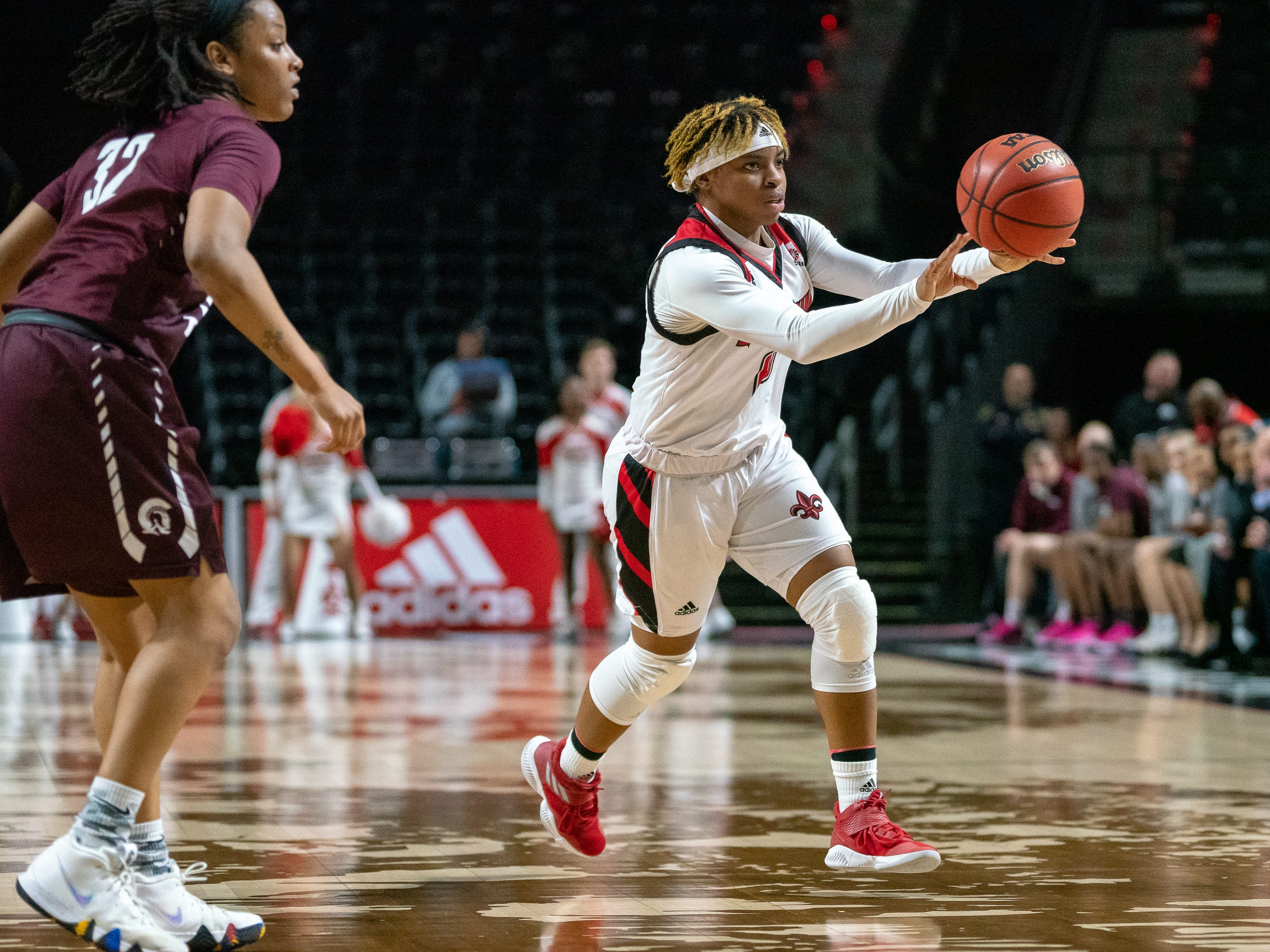 UL's Diamond Morrison throws a pass to a teammate as the Ragin' Cajuns take on the Little Rock Trojans at the Cajundome on Thursday, March 7, 2019.