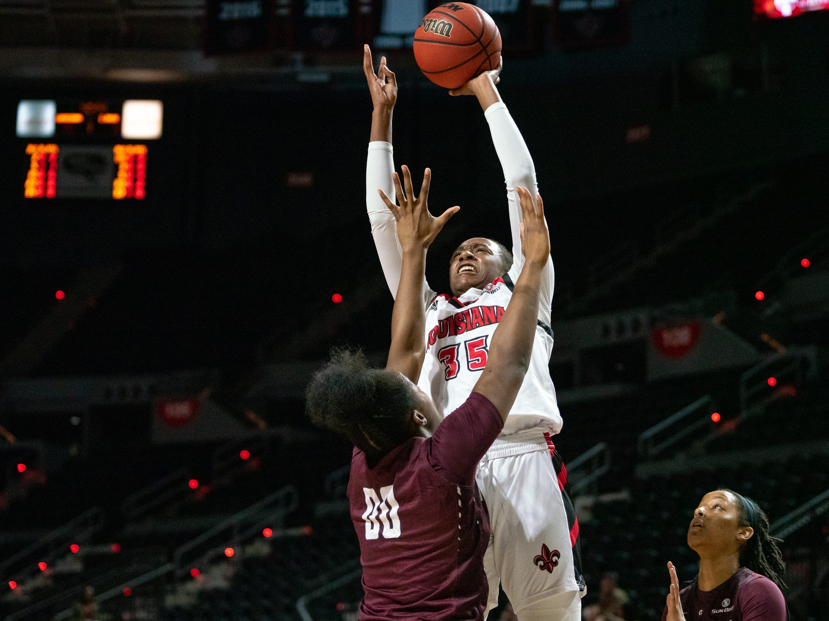 UL's Ty'Reona Doucet scores over a defender as the Ragin' Cajuns take on the Little Rock Trojans at the Cajundome on Thursday, March 7, 2019.