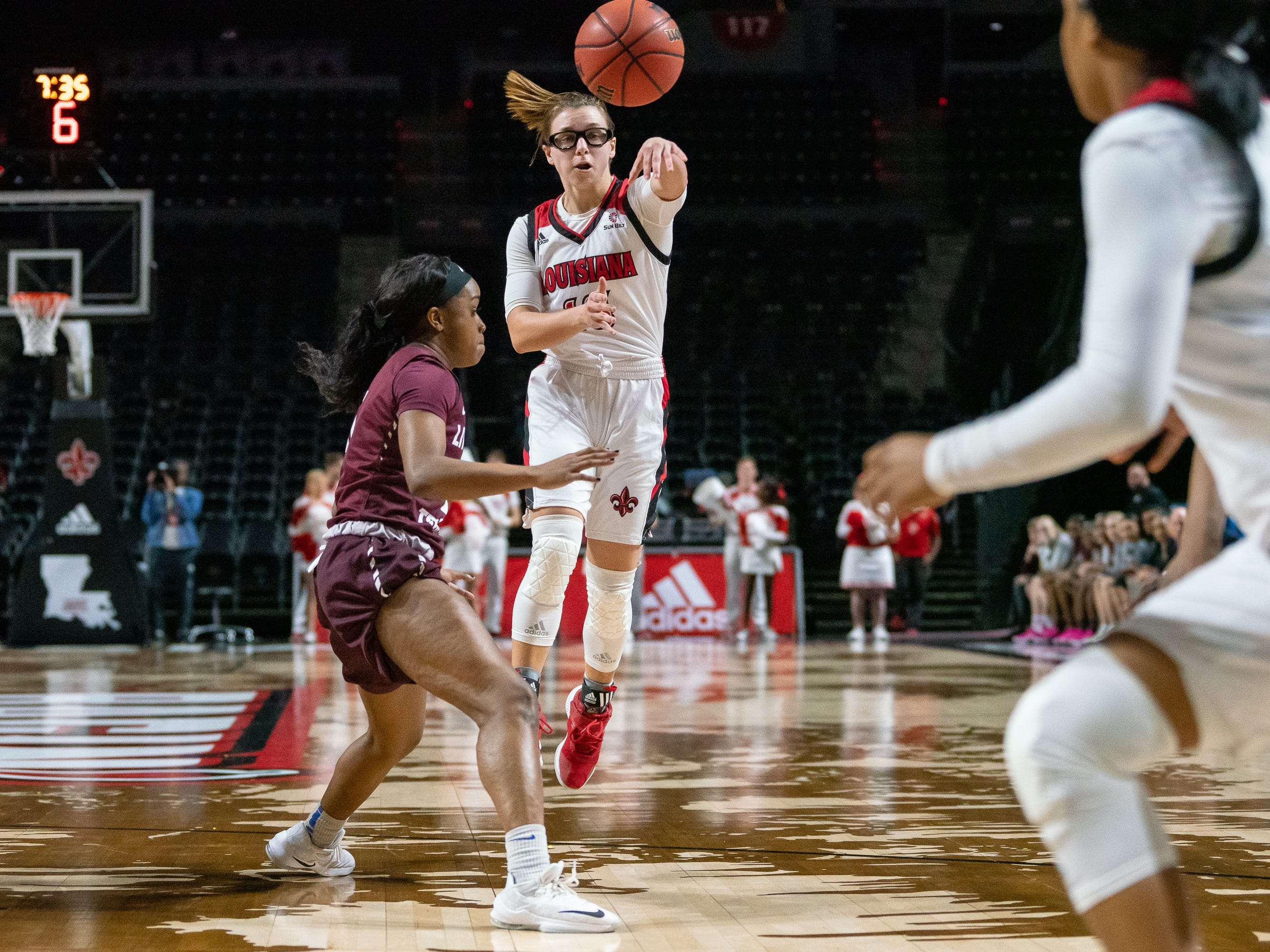 UL's Andrea Cournoyer passes the ball to a teammate as the Ragin' Cajuns take on the Little Rock Trojans at the Cajundome on Thursday, March 7, 2019.