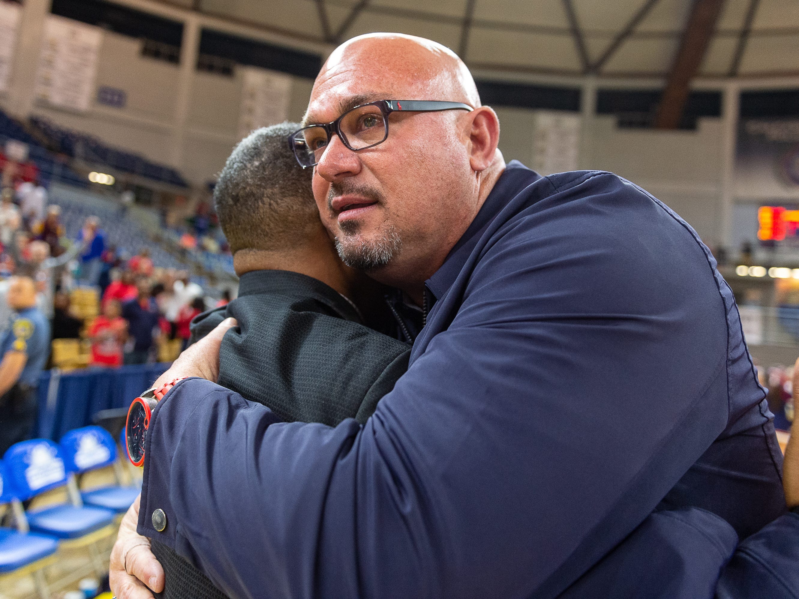 School President Jay Miller congratulates Head Coach Errol Rogers as Lafayette Christian takes down Hamilton Christian to win the Allstate Sugar Bowl/LHSAA Boys' Marsh Madness State Championship. Friday, March 8, 2019.