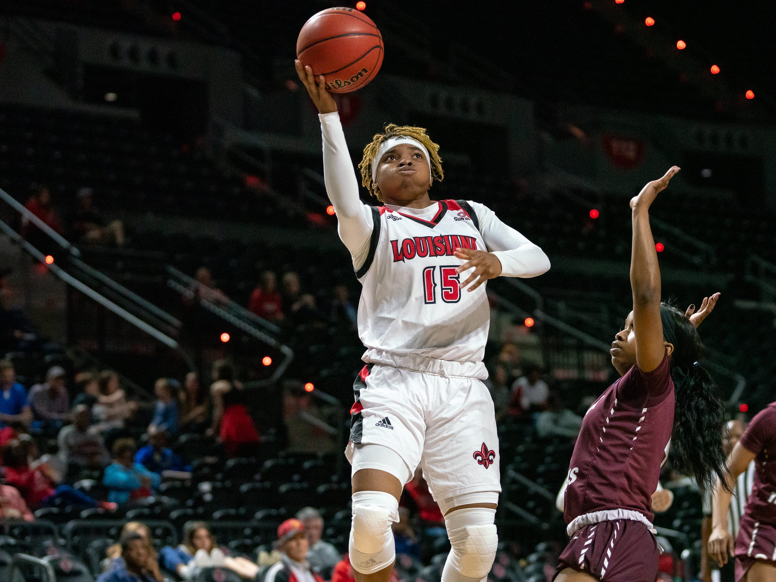 UL's Diamond Morrison scores a layup during the play as the Ragin' Cajuns take on the Little Rock Trojans at the Cajundome on Thursday, March 7, 2019.