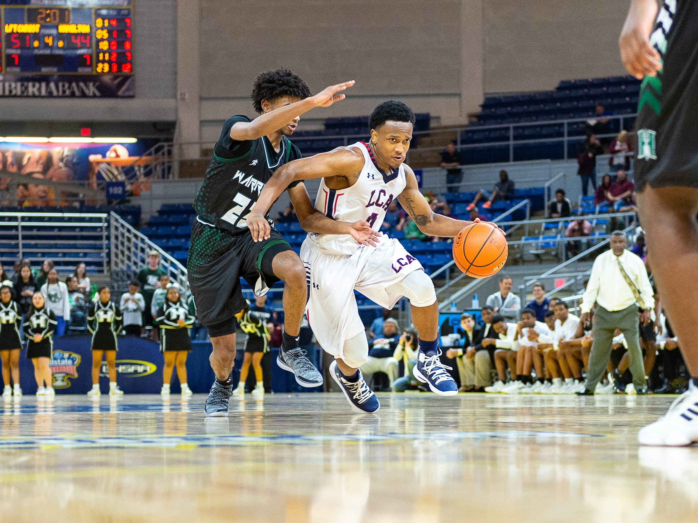 Terrence Jones Jr. drives the ball as Lafayette Christian takes down Hamilton Christian to win the Allstate Sugar Bowl/LHSAA Boys' Marsh Madness State Championship. Friday, March 8, 2019.