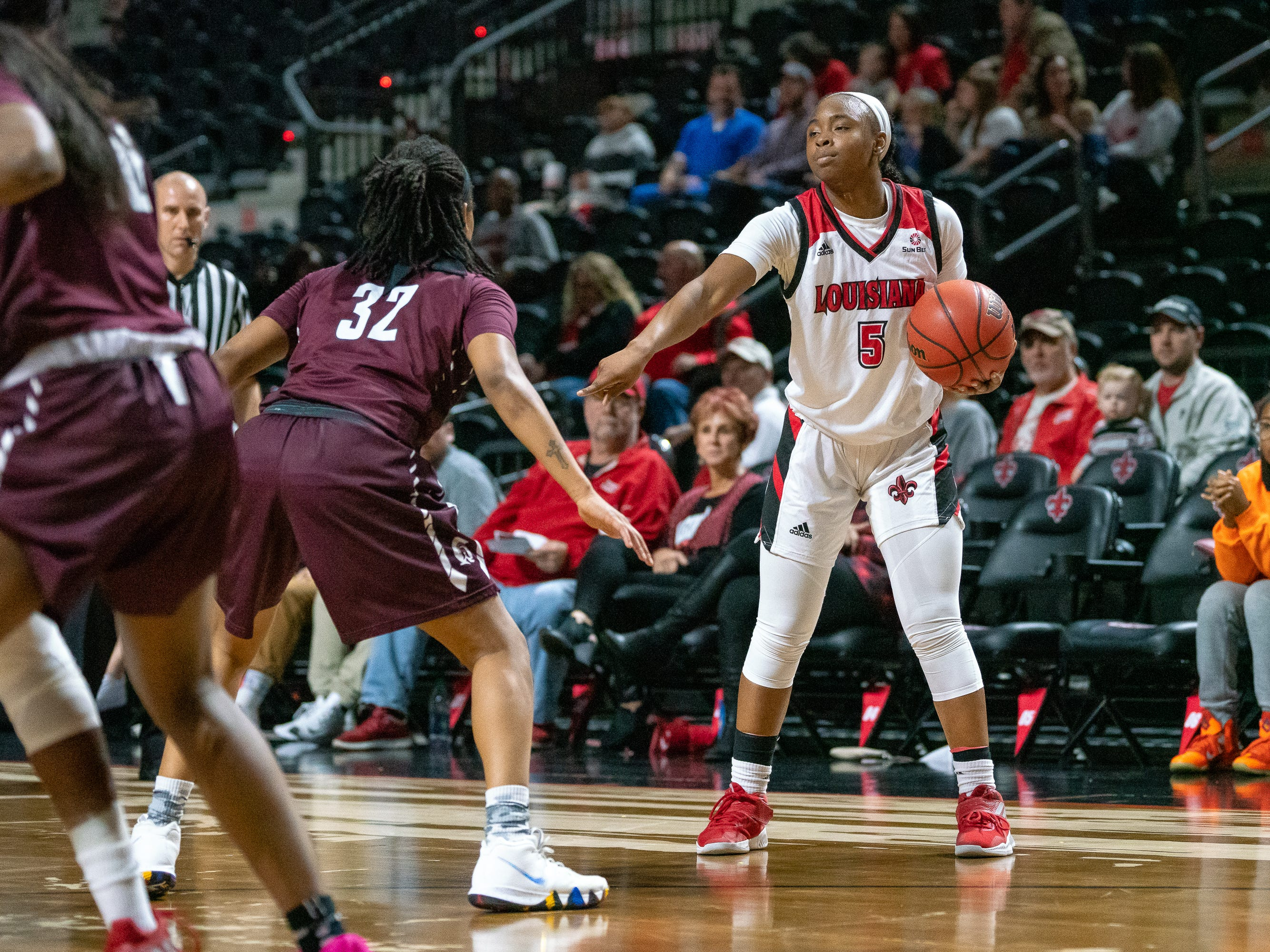UL's Jomyra Mathis directs her teammates on the court as the Ragin' Cajuns take on the Little Rock Trojans at the Cajundome on Thursday, March 7, 2019.