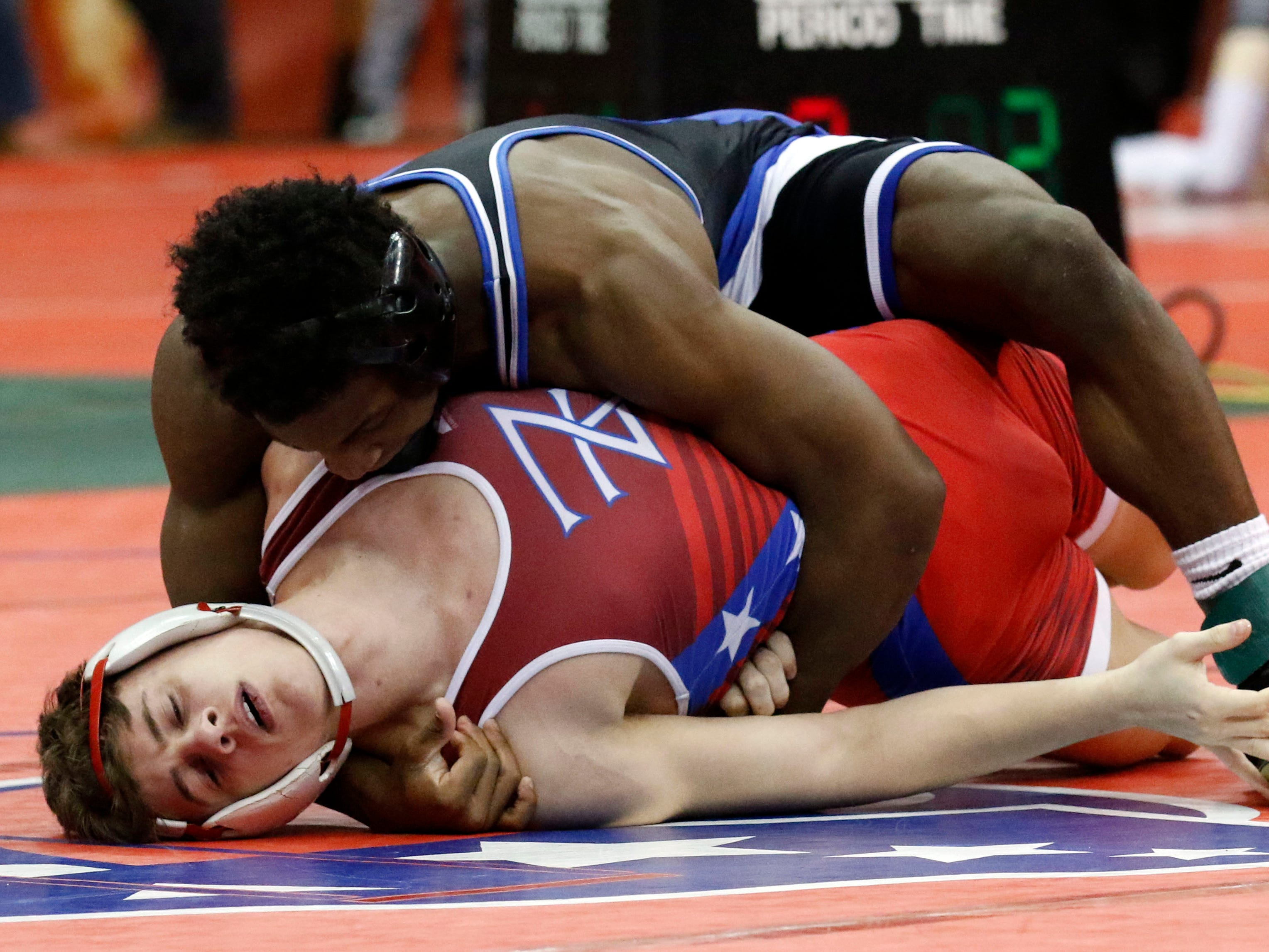 Zane Trace's Jordan Hoselton wrestles Friday, March 8, 2019, during the State Wrestling Tournament at the Jerome Schottenstein Center at Ohio State University in Columbus.