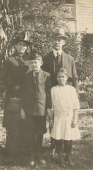 Dr. Harry L. Bounds and wife Maude are shown in this undated photo with their son Denver (1905-1982) and daughter Minerva (Bounds) Baker (1907-2007). They owned the house at 121 W. Mulberry St. from 1911-1934.