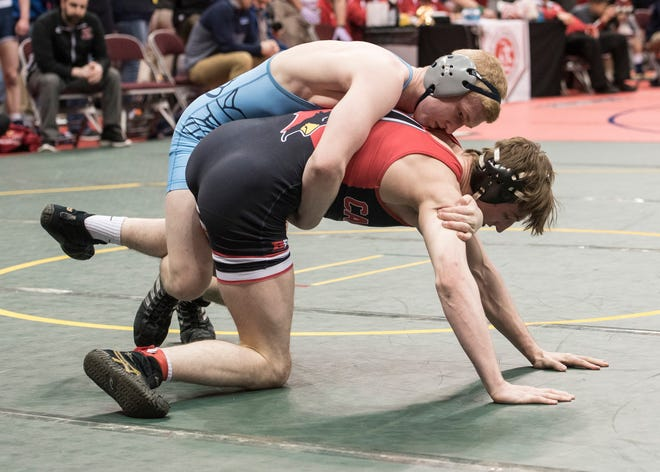 River Valley's Hadyn Danals, top, competes at last year's state wrestling championships at Ohio State's Schottenstein Center. Danals was projected to make the finals of the Division II 170-pound class with his undefeated record.