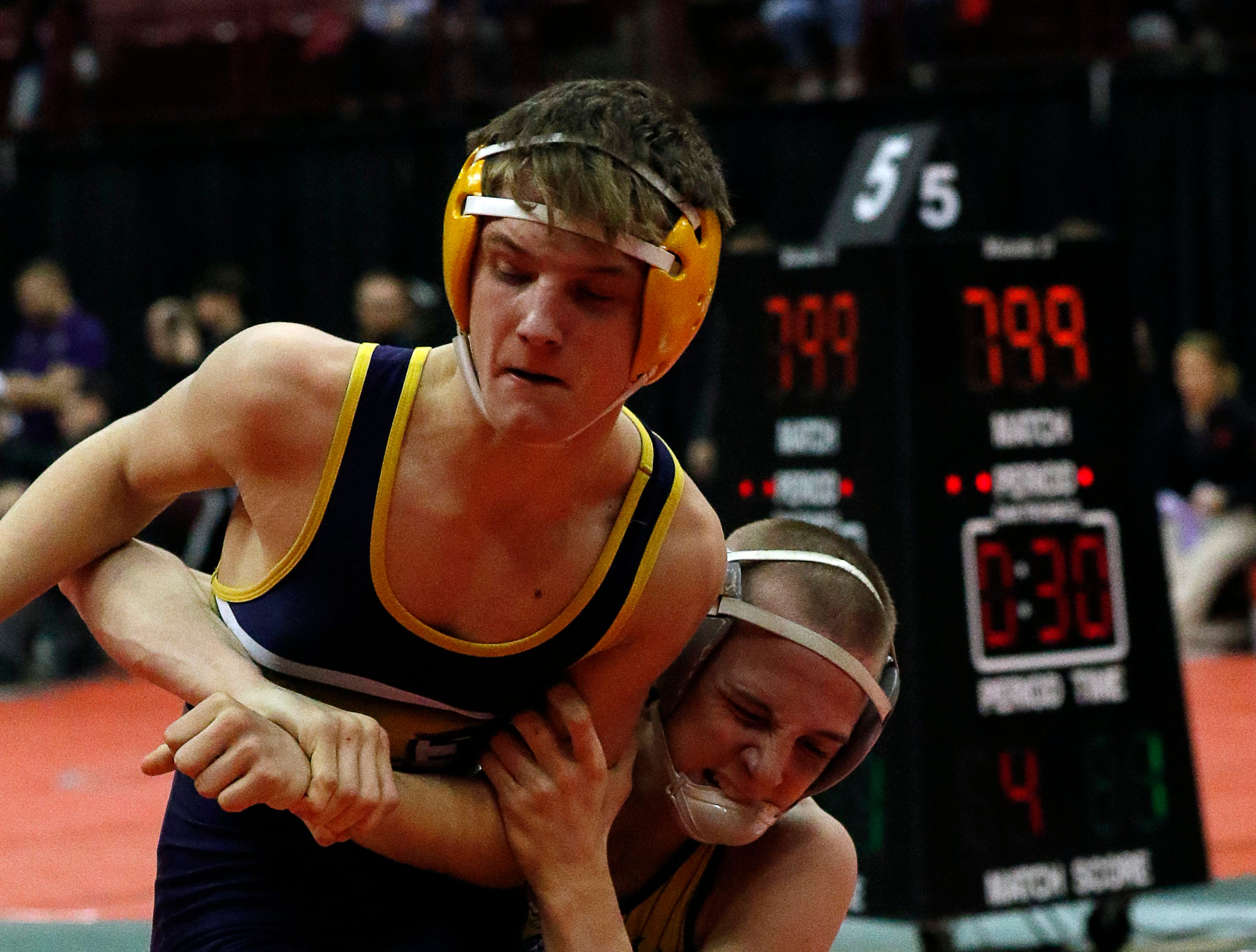 Lancaster's Jacob Reed wrestles during a consolation round match Friday, March 8, 2019, during the State Wrestling Tournament at the Jerome Schottenstein Center at Ohio State University in Columbus.