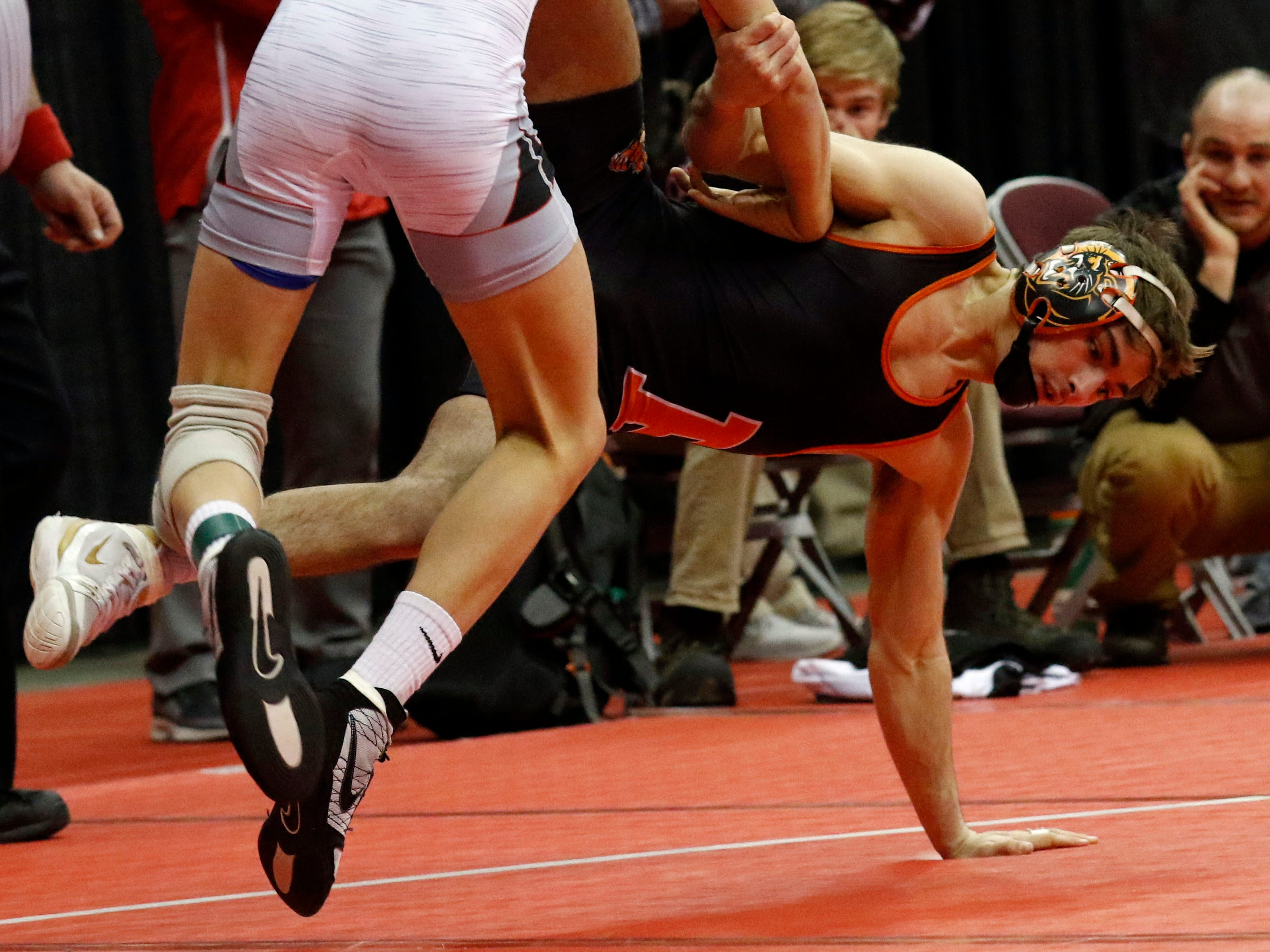 New Lexington's Blake Sheppard wrestles during the State Wrestling Tournament Thursday, March 7, 2019, at the Jerome Schottenstein Center at Ohio State University in Columbus.