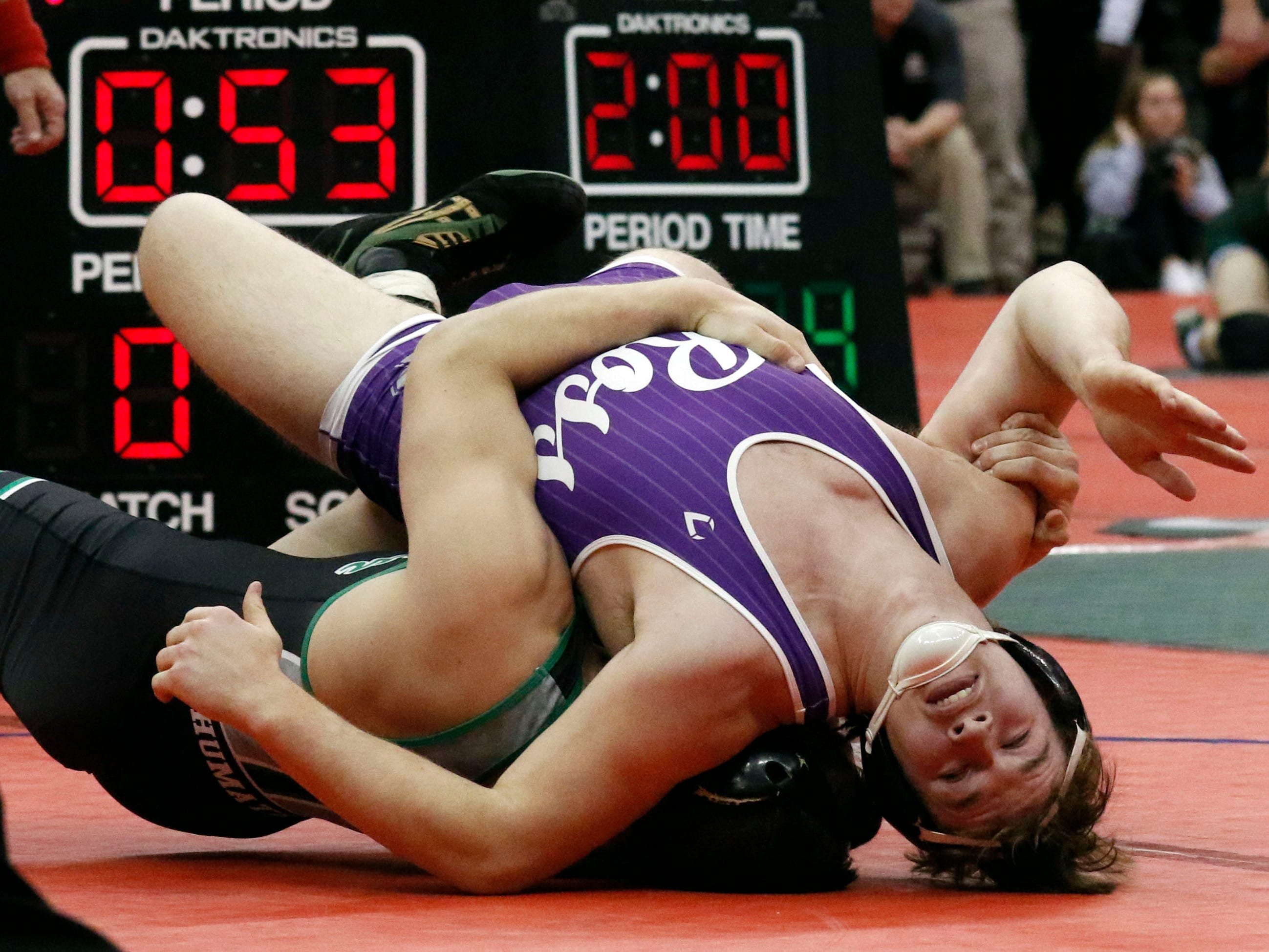Fremont Ross's Caleb Wood wrestles Friday, March 8, 2019, during the State Wrestling Tournament at the Jerome Schottenstein Center at Ohio State University in Columbus.